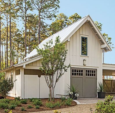 This Southern Living carriage house is beautiful. I love the white exterior and the contrast with the gray doors.