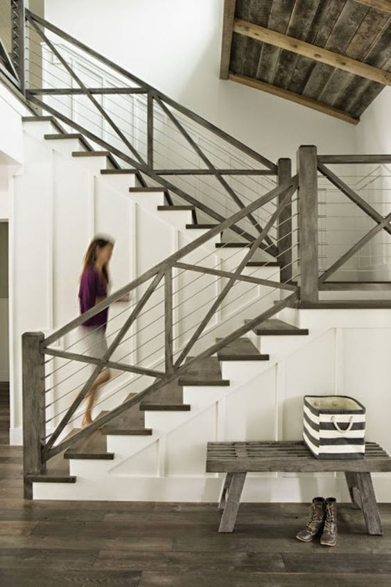 This staircase was my inspiration for the interior. I wanted the wood, the cable rods, and I love the dark gray wash. My floors upstairs in both Bride's and Groom's suite will be very similar to these floors you see here.