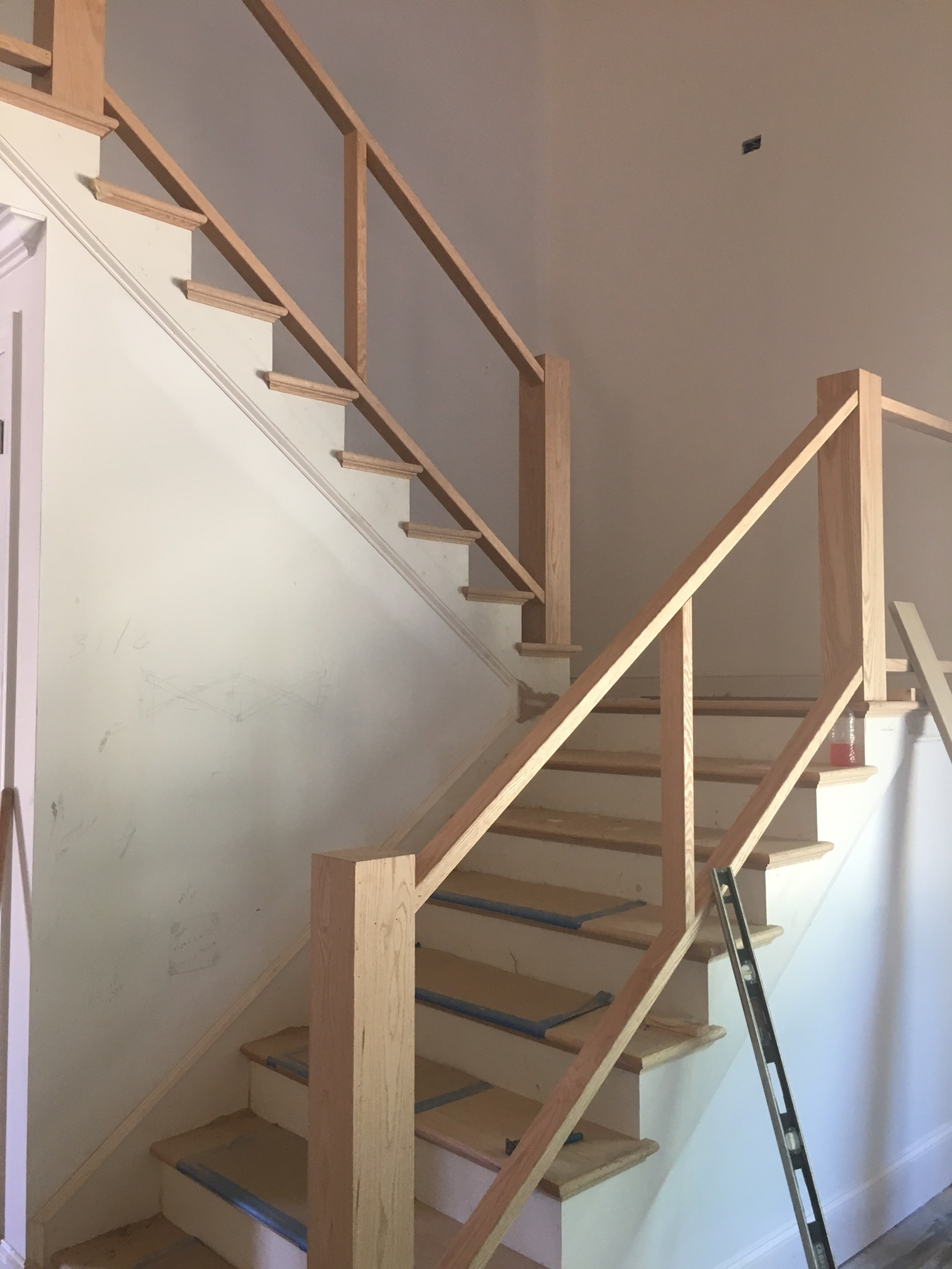 Staircase being built; it will be stained in a similar gray wash like the trusses and to match the floors upstairs.