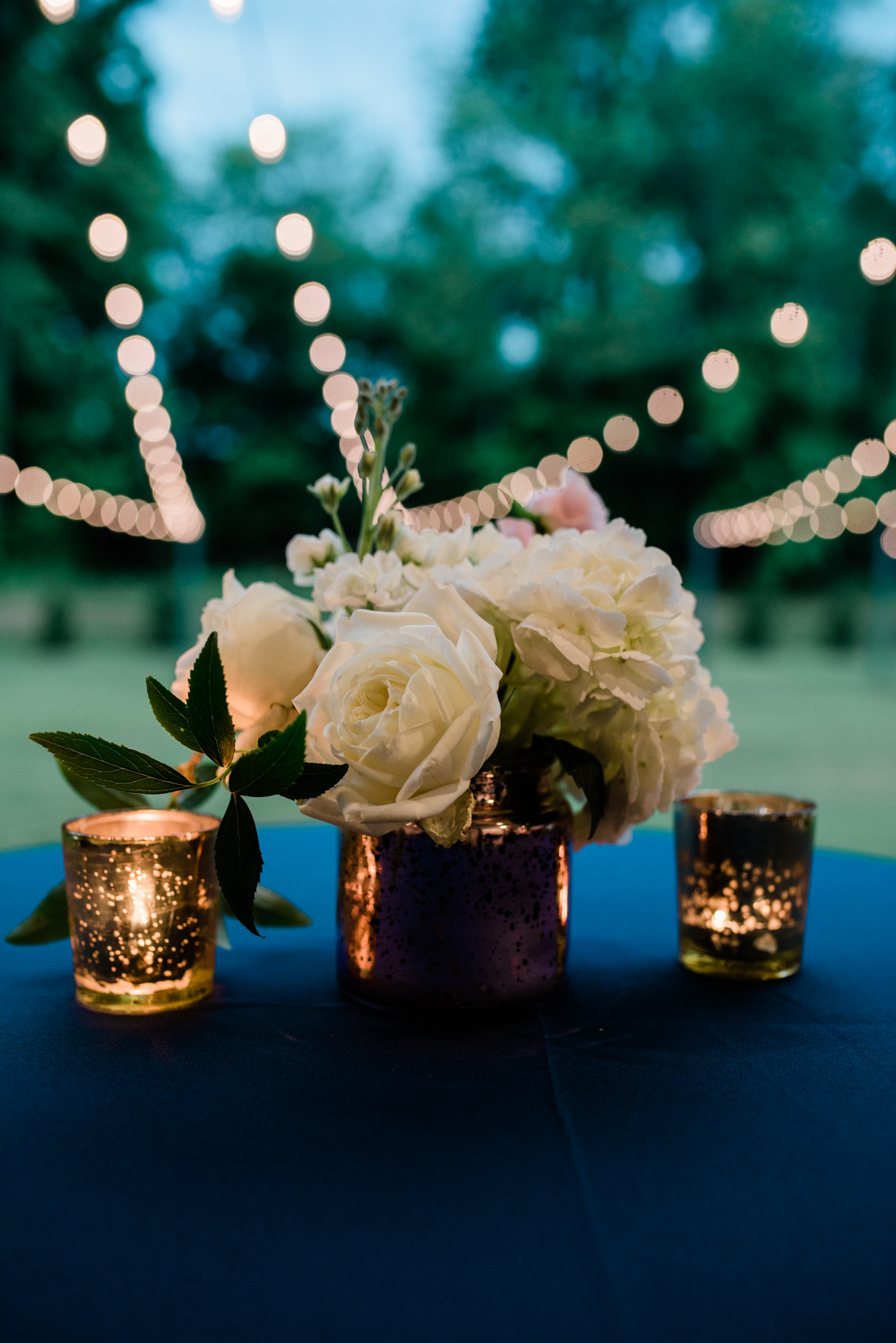Wedding Floral arrangement with mercury glass candles.jpg