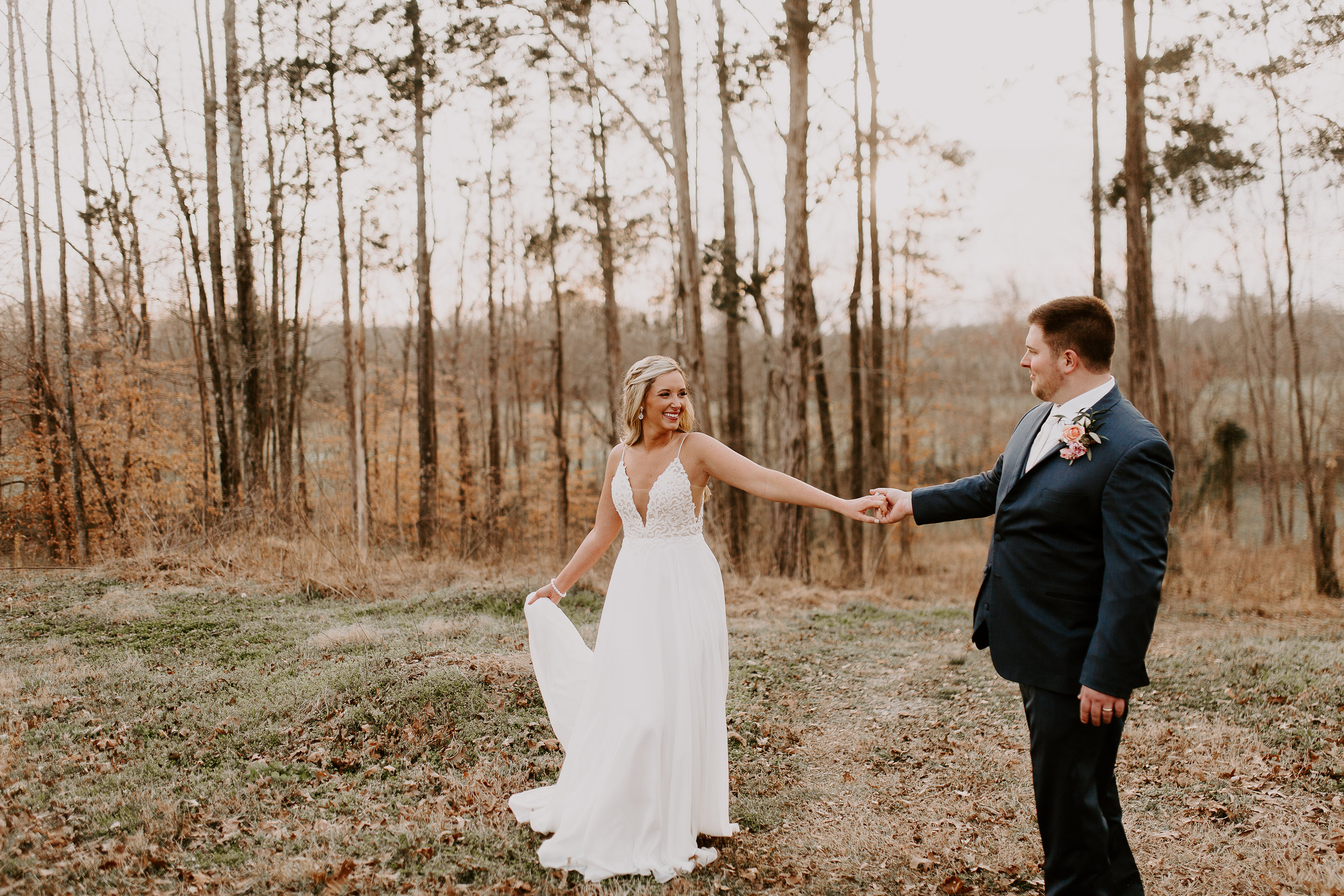 Bride and Groom Dancing in the woods