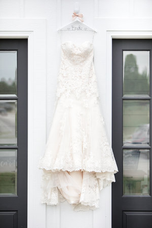 Wedding Gown against white walls and black doors