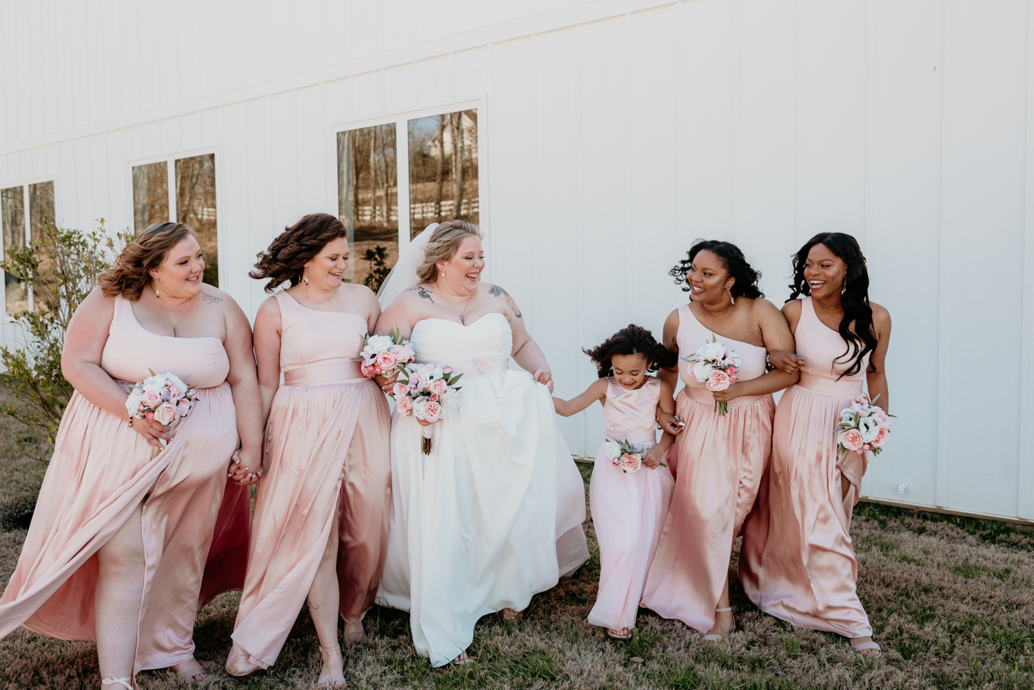 bridesmaids holdong hands .jpg