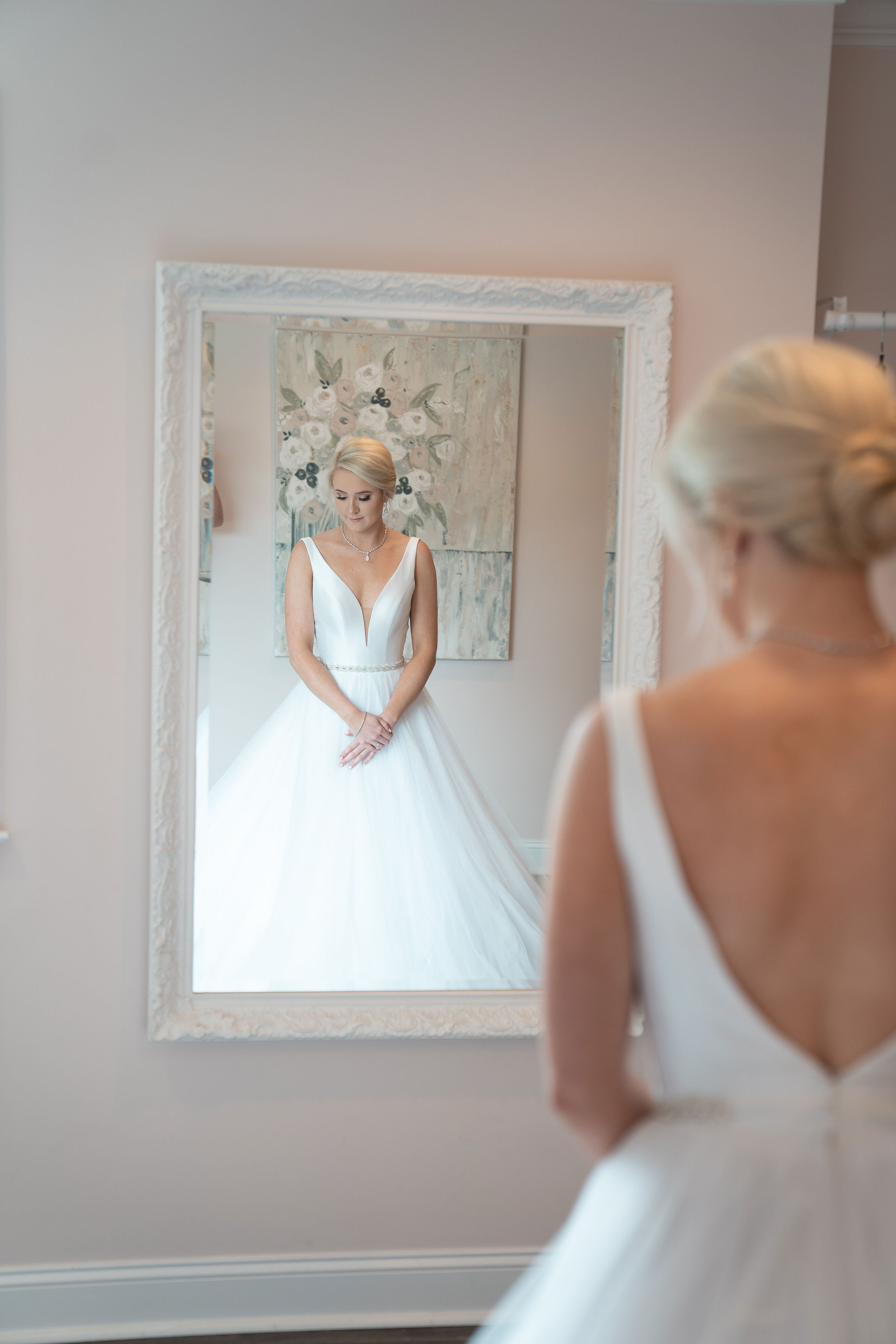 bride infront of antique white mirror .jpg