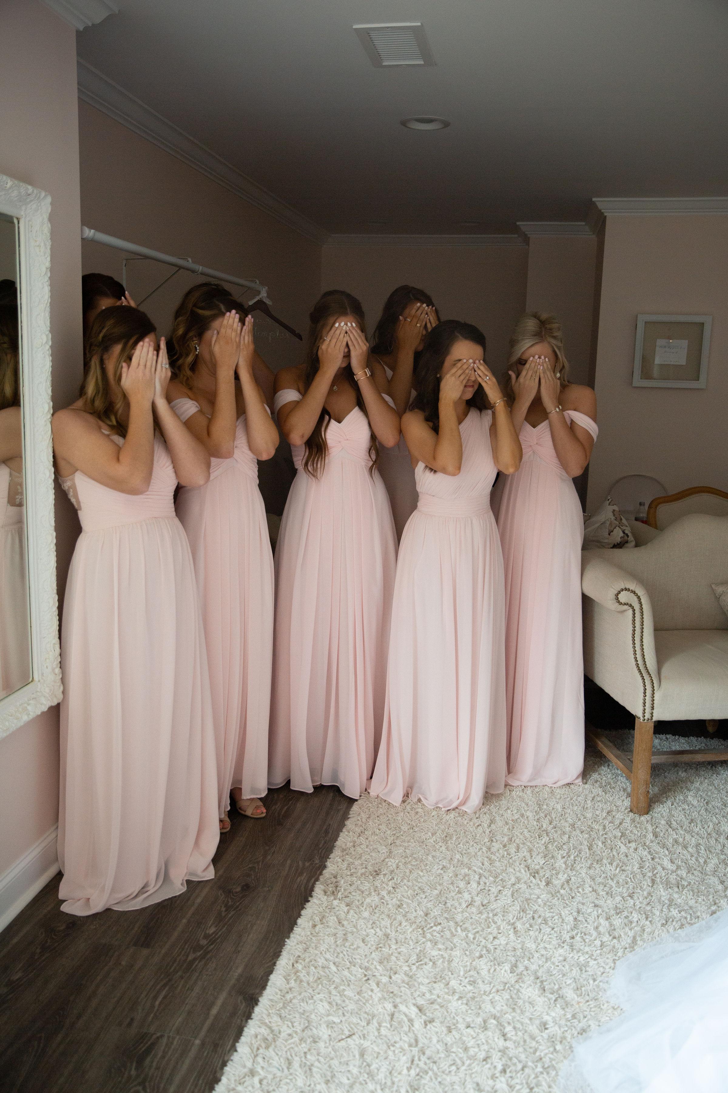 bridesmaids eyes covered .jpg