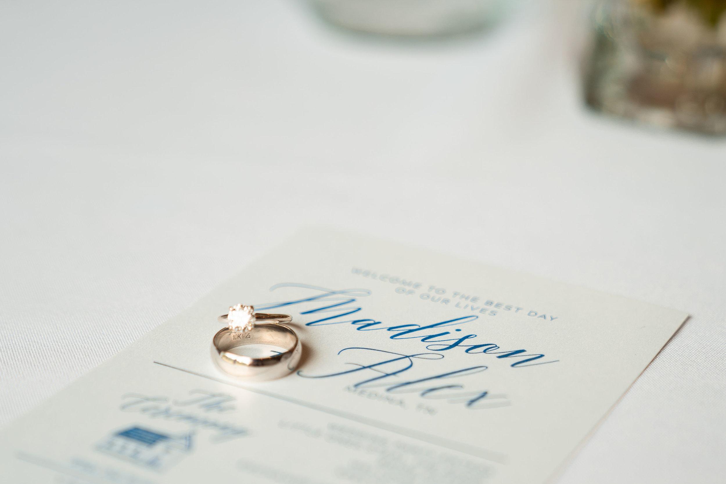 Ring and invitation detail shot .jpg