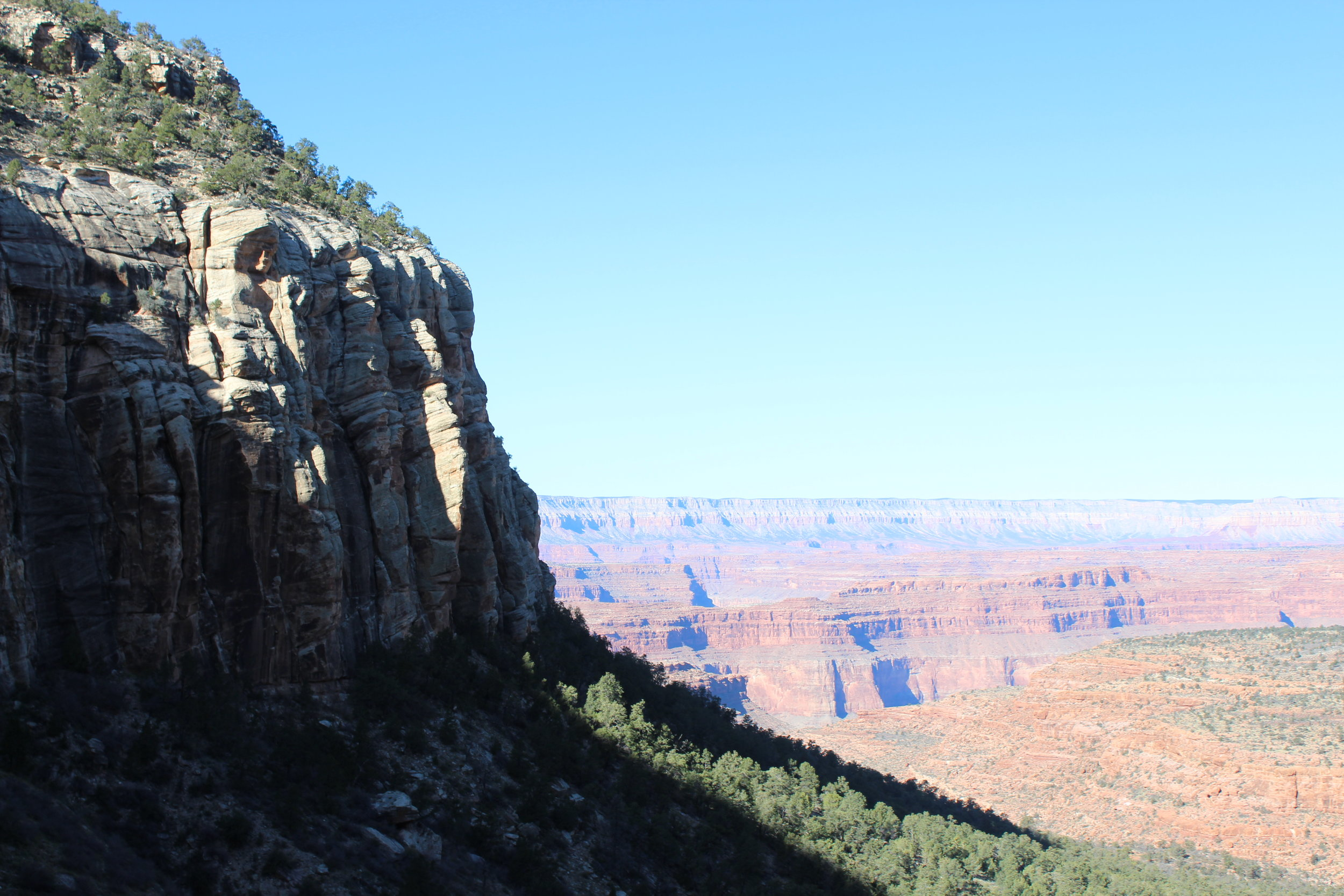 Only a few spots penetrate the sheer Coconino cliffs