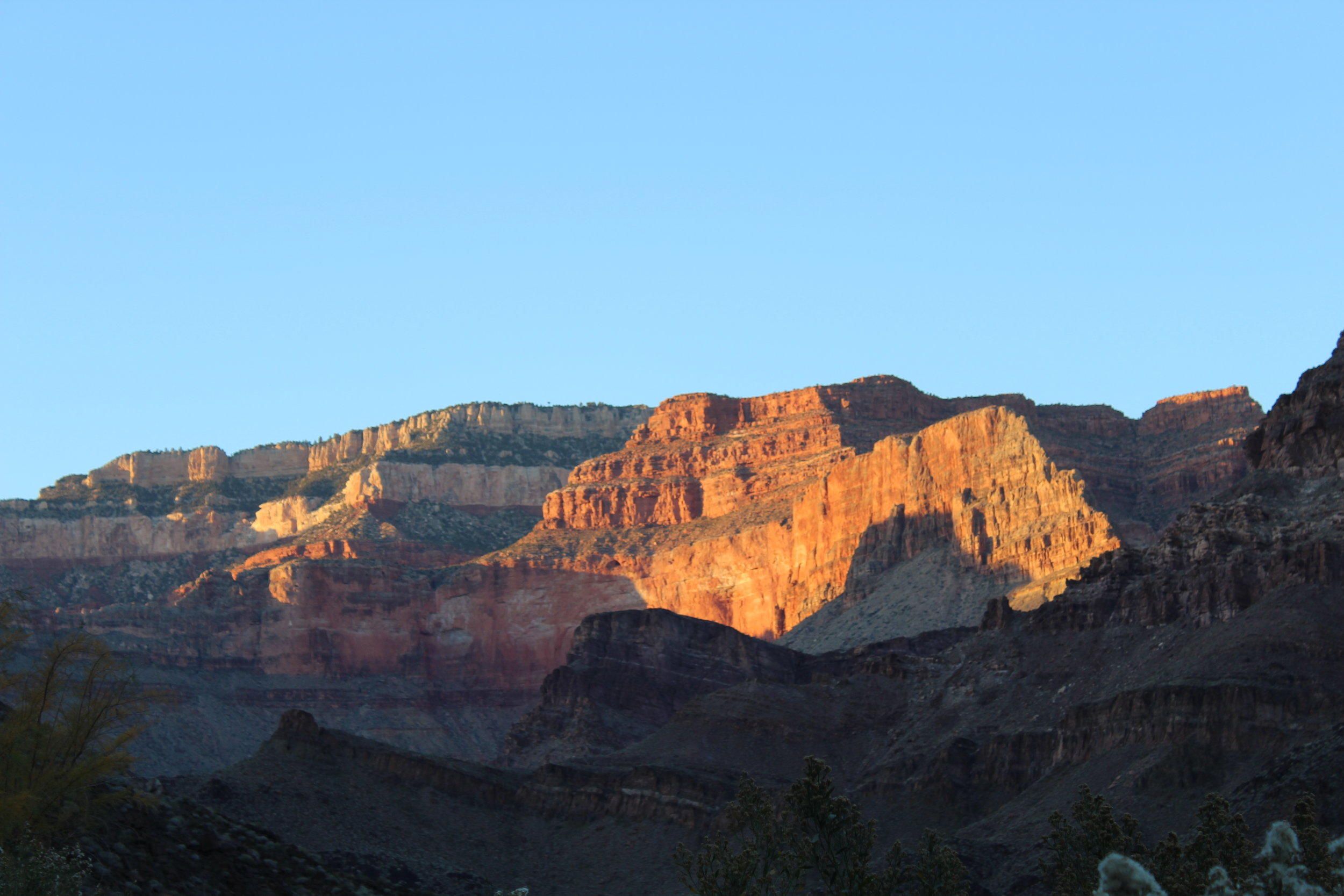 Sun sets on the upper walls of the north rim.