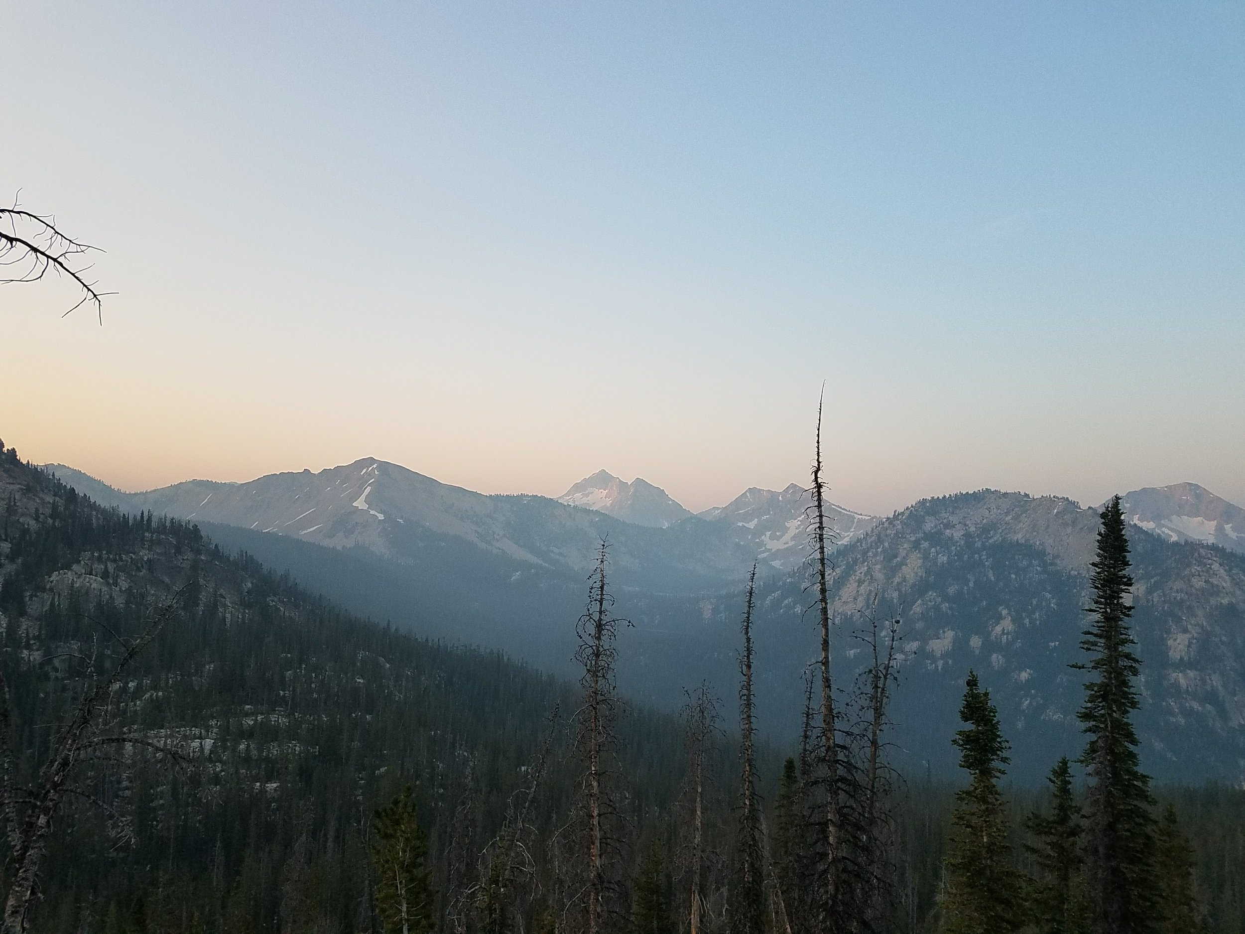 Early morning in the Sawtooths. At 6:30, it was light enough to get a picture. That's Snowyside Peak in the center.
