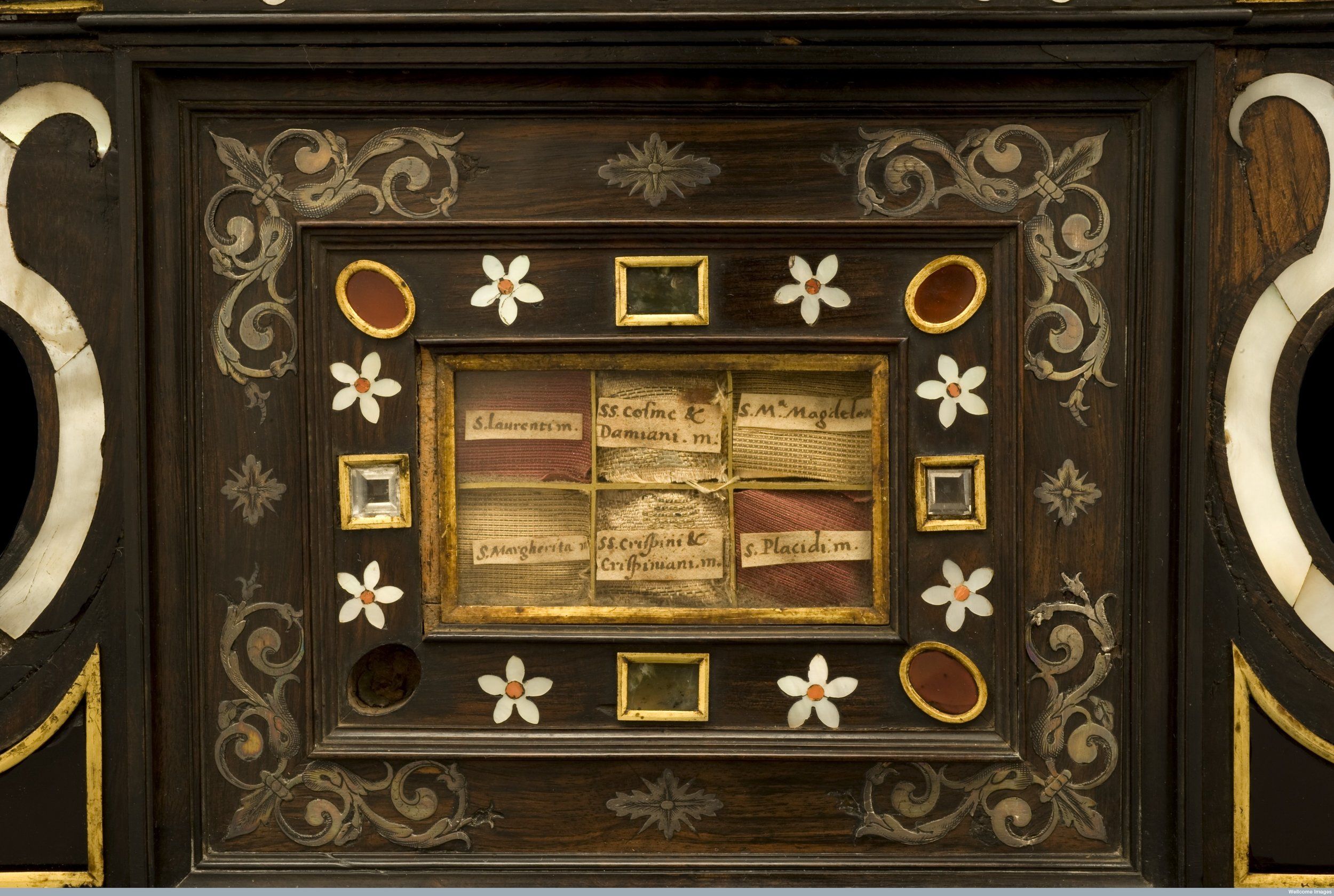 Elaborately carved and inlaid wooden reliquary chest containing relics of several saints, Spanish 18th century.  Wellcome Images L0058440.