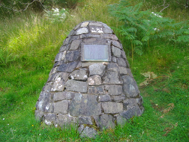 """Image of the 'Appin Murder Cairn' which commemorates the spot upon which the murder occurred. The plaque on the cairn reads """"This cairn is erected on the spot where Colin Campbell of Glenure was murdered on 14 May 1752. Image Author Euan Nelson, reproduced from  Wikimedia Commons ."""