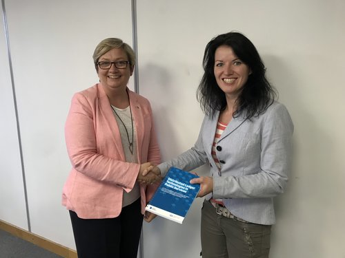 Wallet.Services' Hannah Rudman presenting Joanna Cherry MP with DLT Report