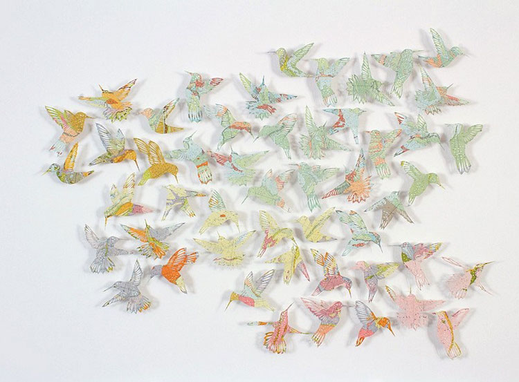 Paper Birds, an installation made out of cut-out atlases, by Claire Brewster.  Sourced from mymodernmet.com.