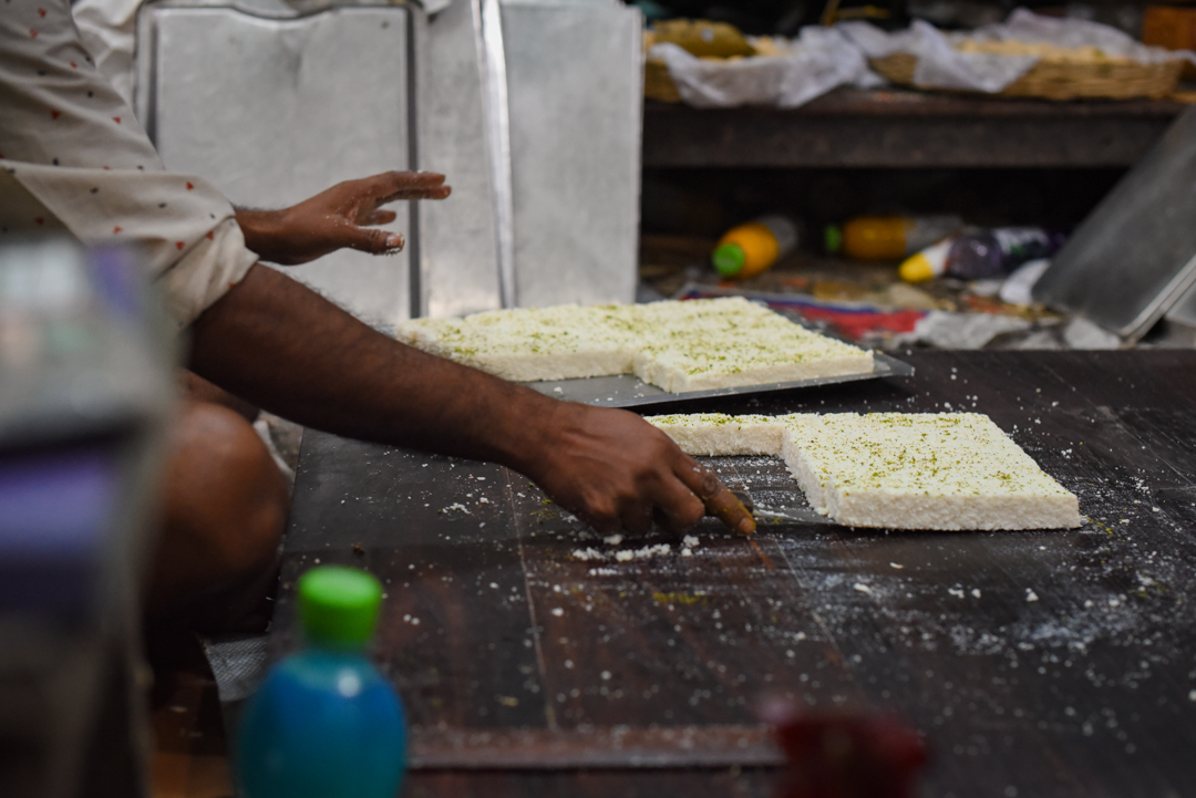 The art of balancing rows of soft sandesh on a knife.