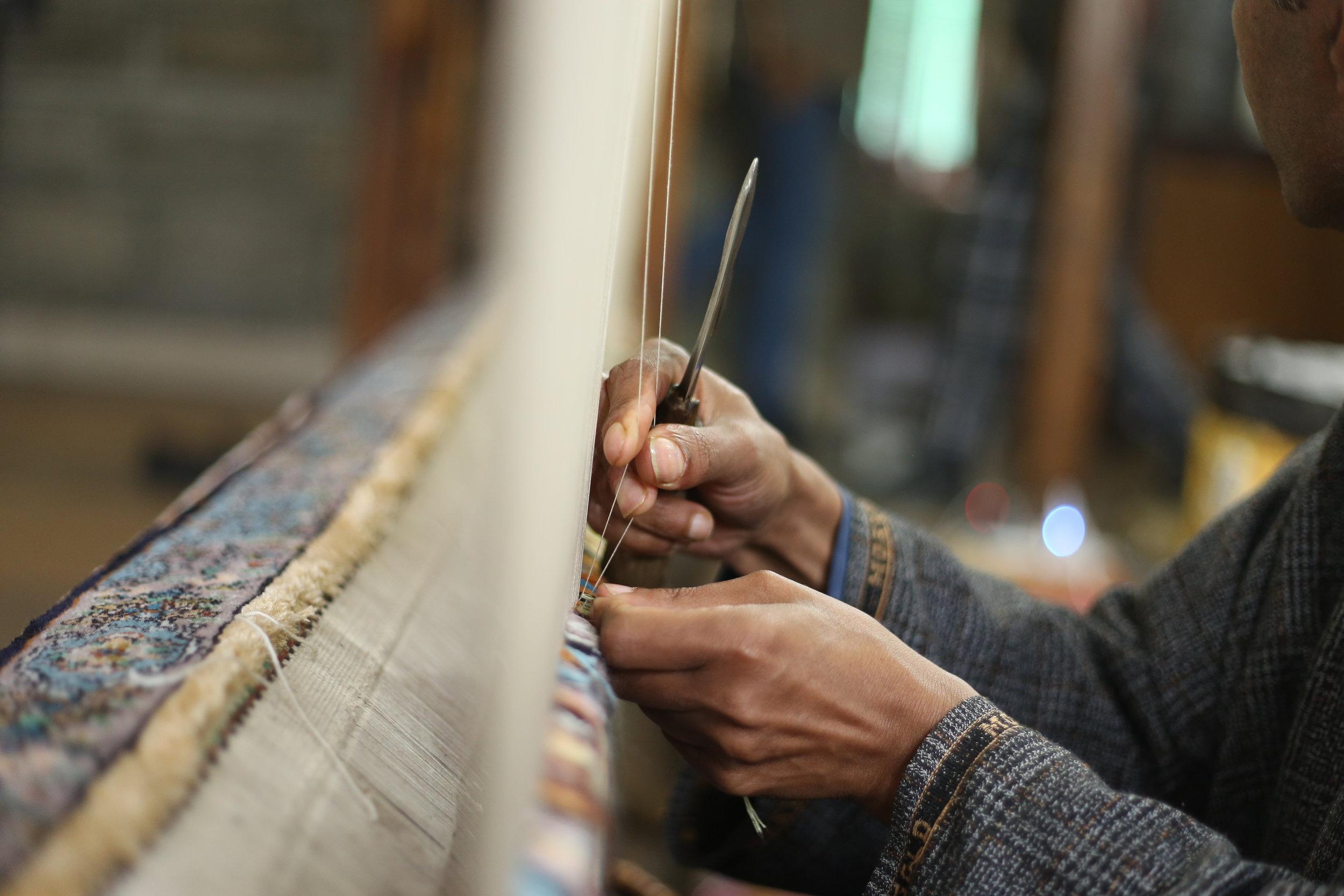 Hands at work, making a Kashmiri Carpet