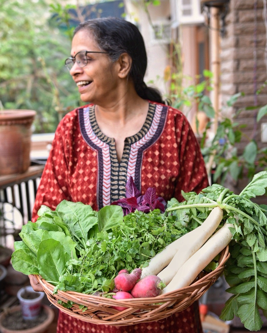 - Ma with a basketful of winter vegetables from the farm.