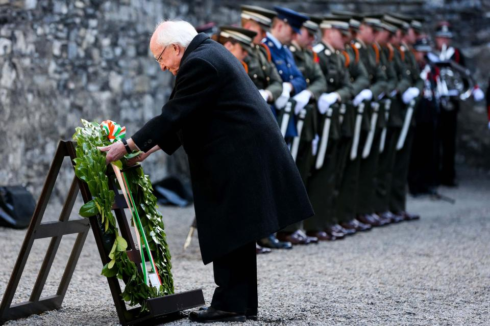 President Michael D. Higgins laying a wreath at the Easter Sunday Wreath-laying ceremony in Kilmanham Gaol