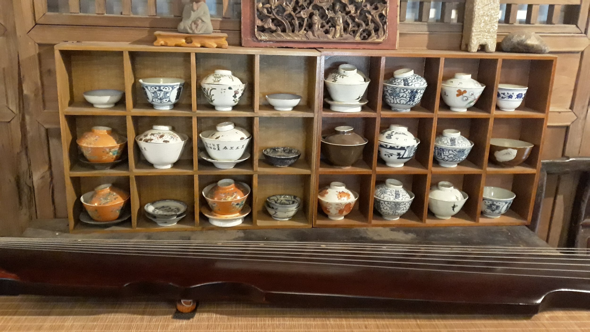 Collection of gaiwan (three piece tea cups) and a qin (string instrument) in Ciqikou town near Chongqing, China