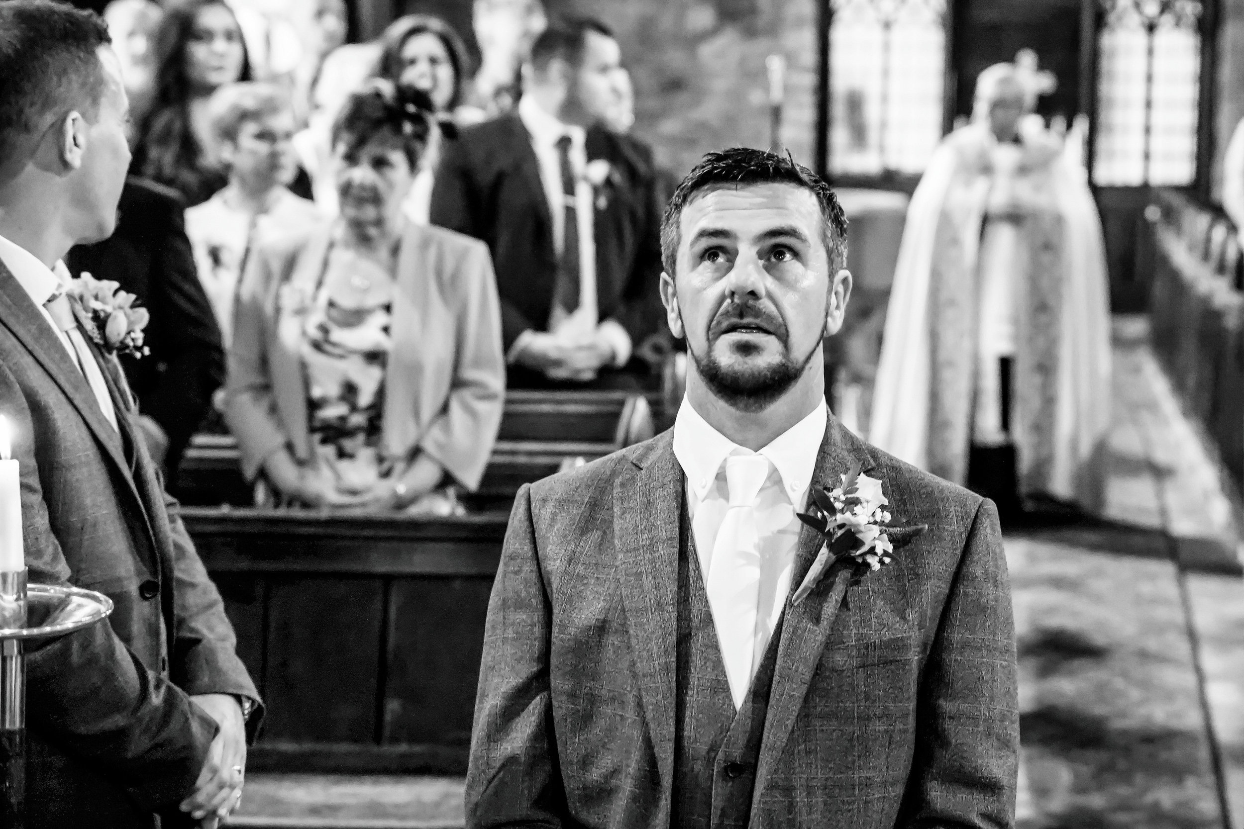 Awaiting the arrival of his Bride. Documentary Wedding Photography by James; Nia & James The Photographers
