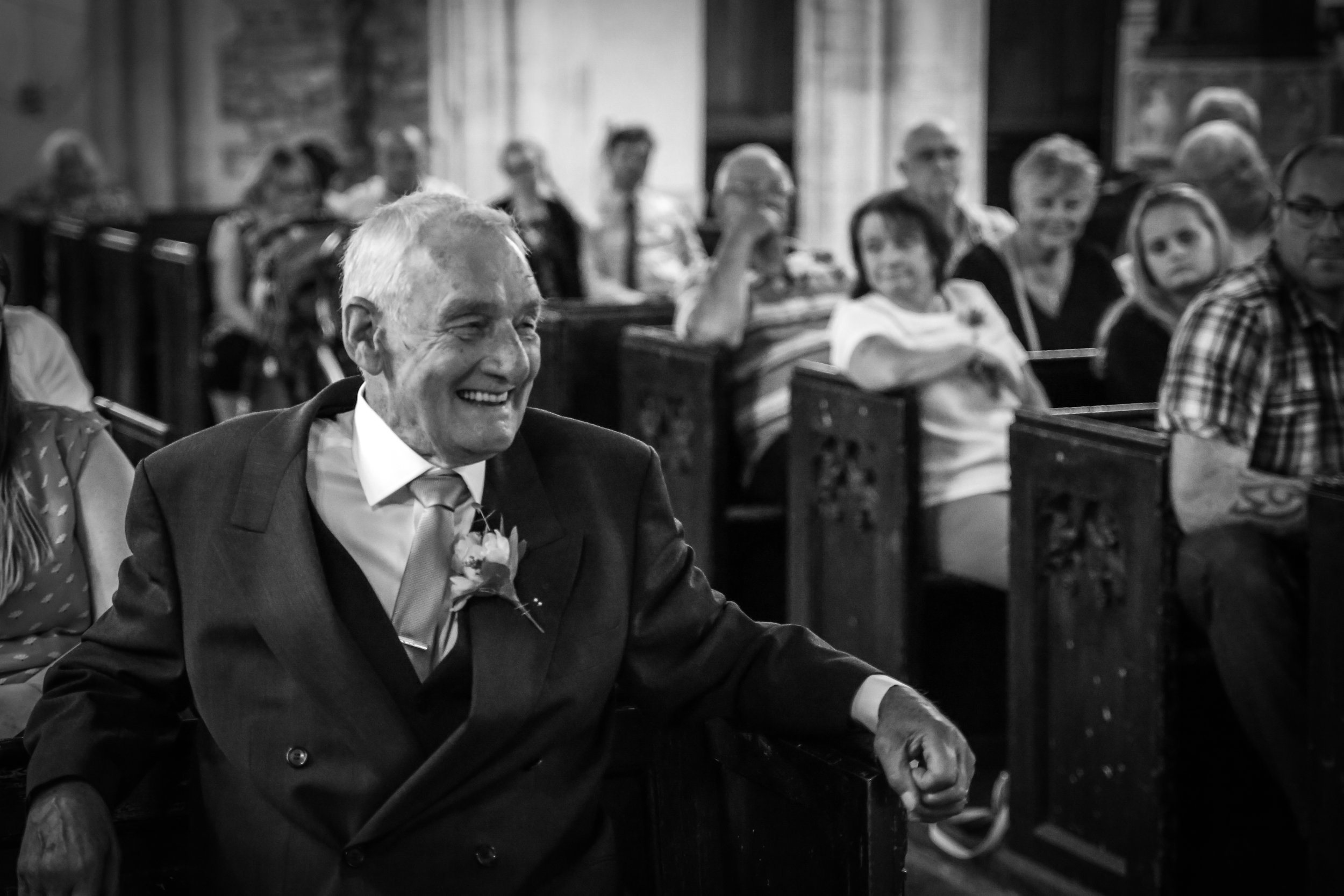 Happy Smiles from the Groom at his Cambridge Wedding. Reportage wedding photographer - Nia & James The Photographers