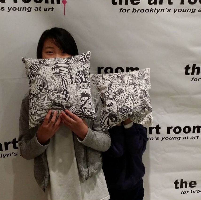 Awesome zentangle pillows created by two of our Drawing & Design students! Canvas pillow, pencil, fabric marker. Ages 8-11