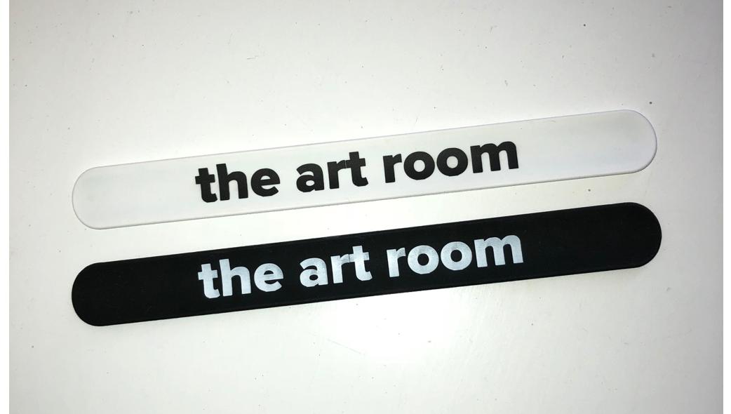 """""""Slap"""" bracelets, black or white.   Purchase your Art Room bracelets    here   !"""