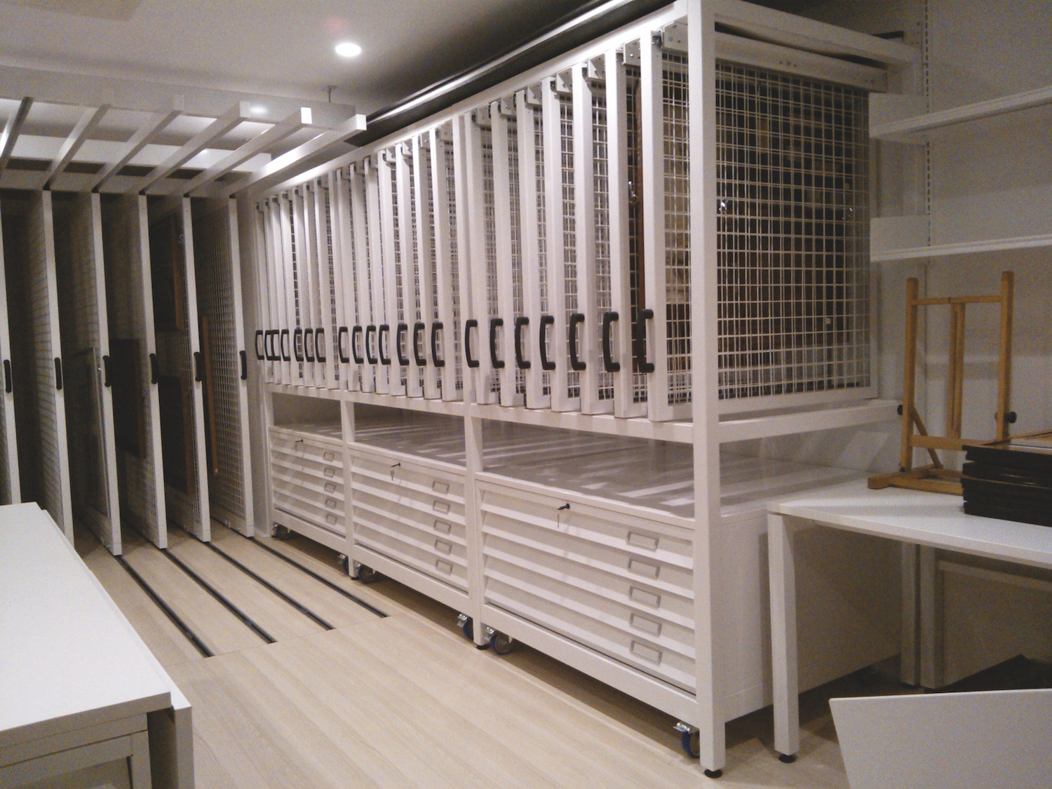 Half height picture racking with moveable plan chest below.