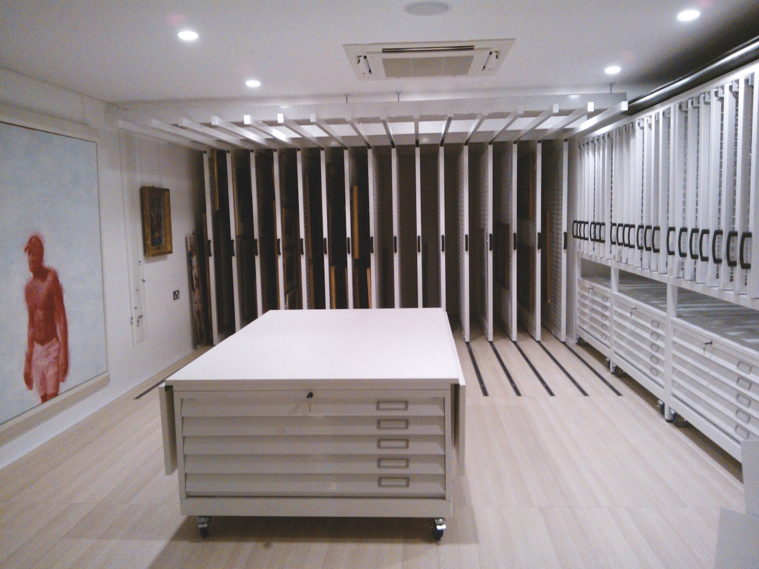 Plan chest topped with a foldable work surface with full height picture racking behind.