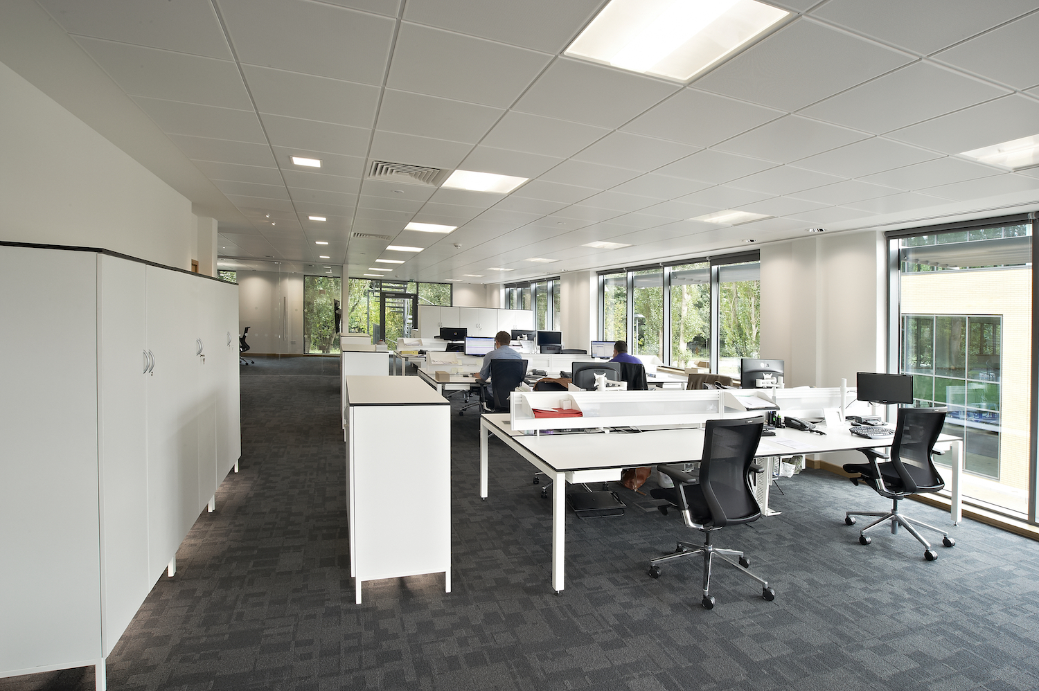 Raised under-lit storage units with contrast edging to complement D50 desking.