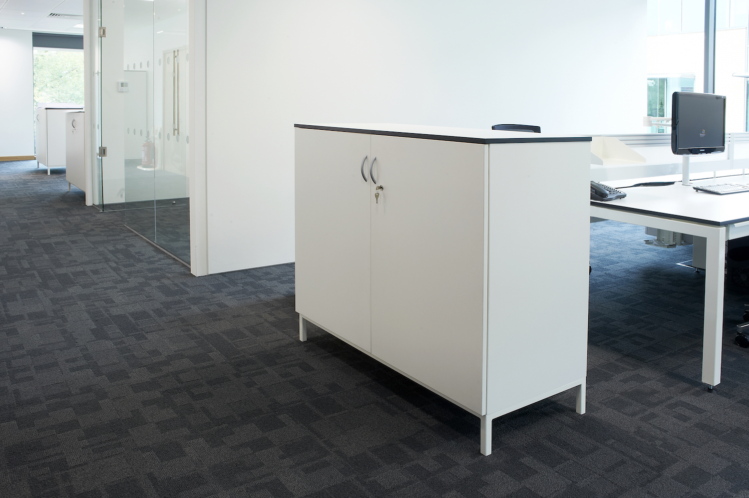 Under lit raised storage units in white mfc with black contrast edging
