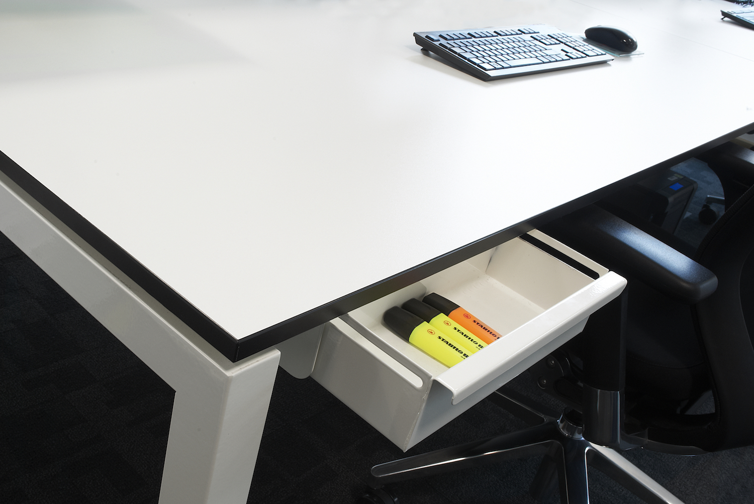 White D50 Bench Desk featuring black contrast edged 18mm top and bespoke integrated pen trays.