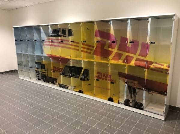 DHL chose a steel carcass with branded transparent polycarbonate doors with dramatic results.