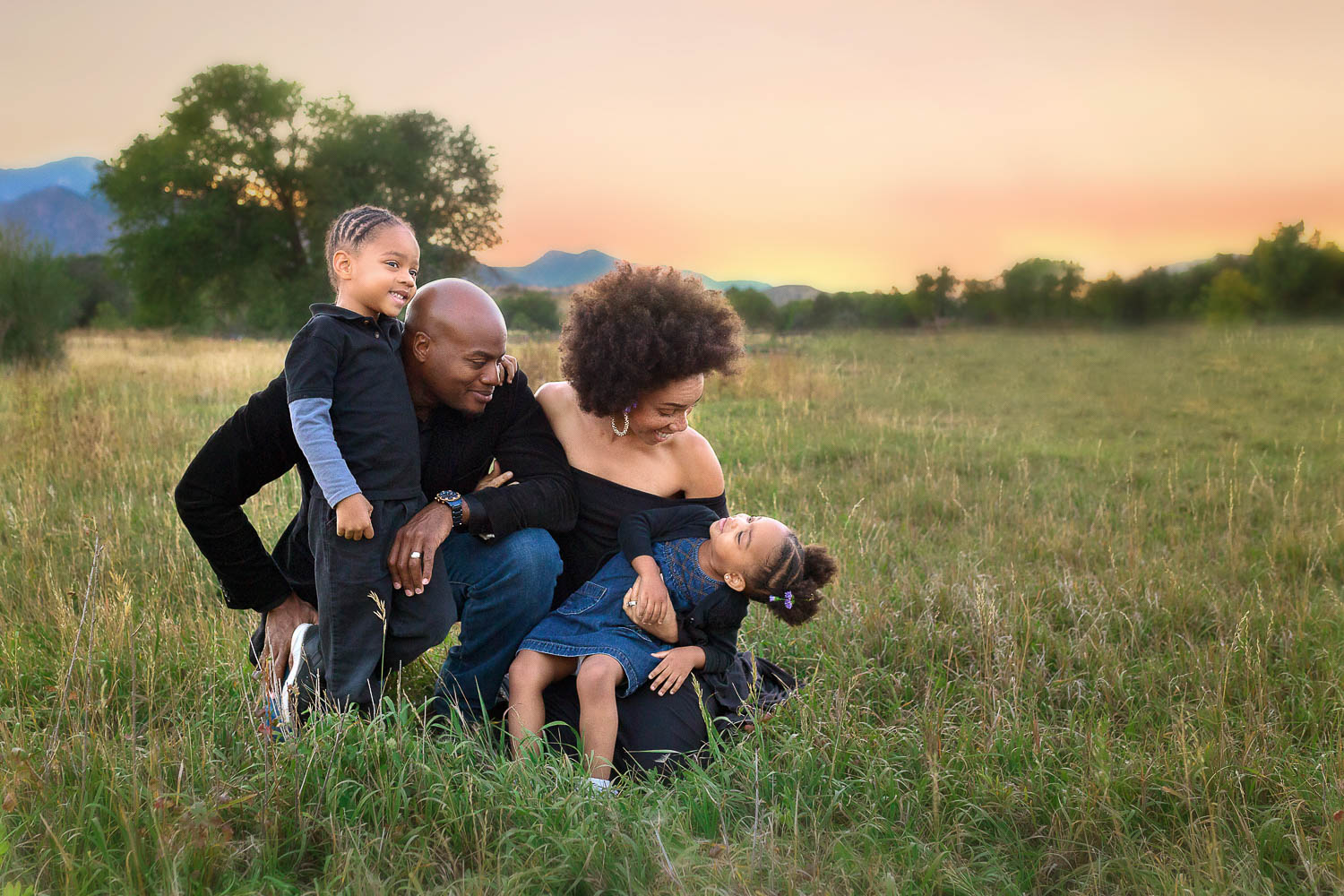 african-american-family-laughing-snuggling-in-colorado-field-alexa-kiel-photography-6.jpg