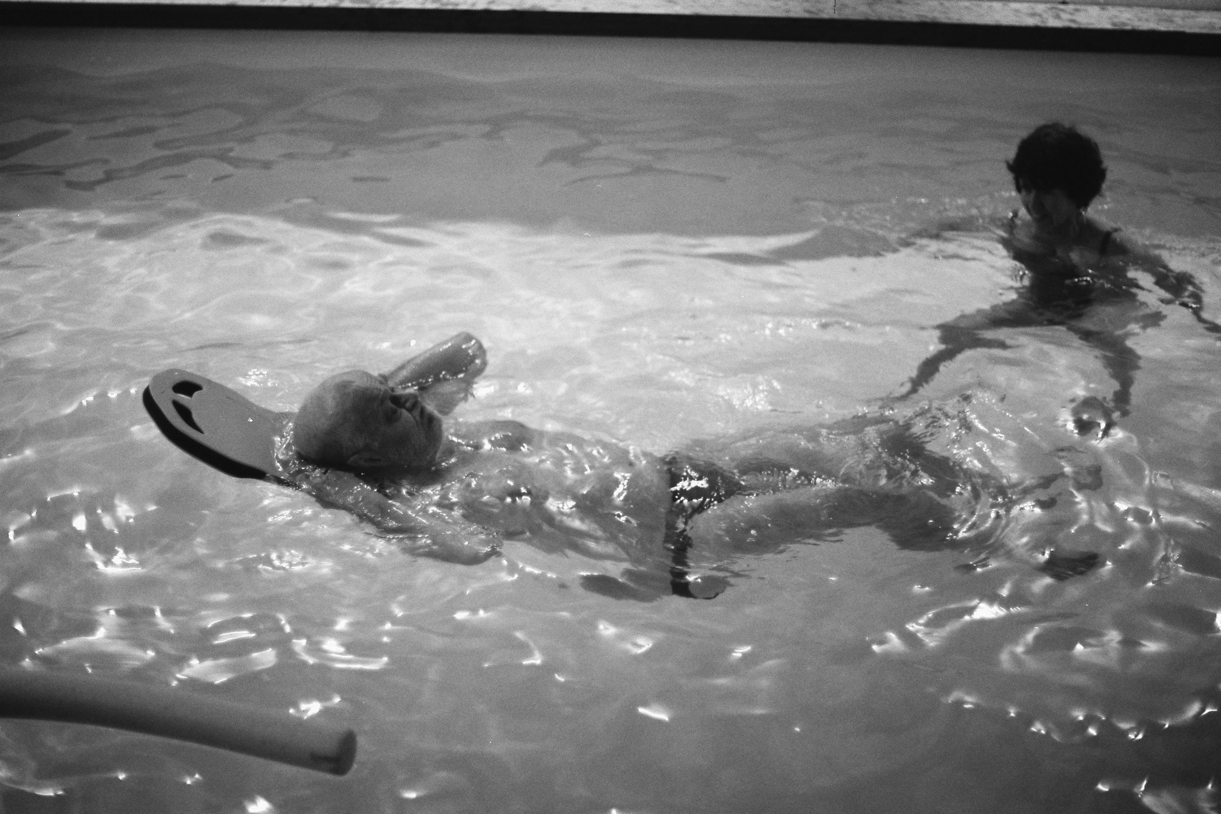 [My parents in our swimming pool]