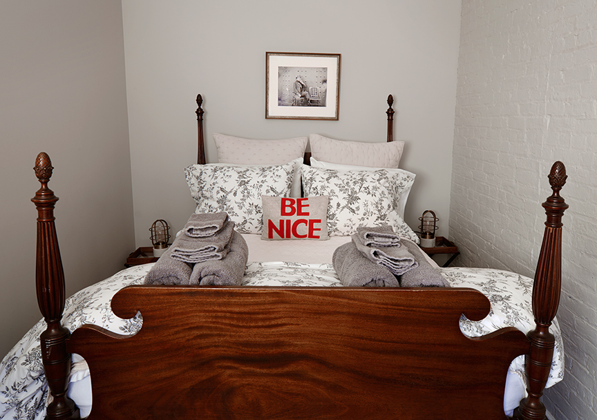 "The Pennington Suite - ""Be Nice"" pillow on 4 poster double bed in private 2nd room"