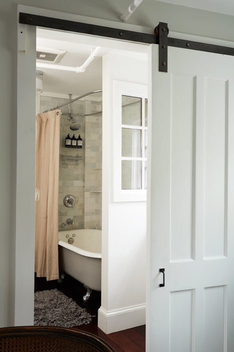 James Louis bathroom with sliding barn door and clawfoot tub and shower