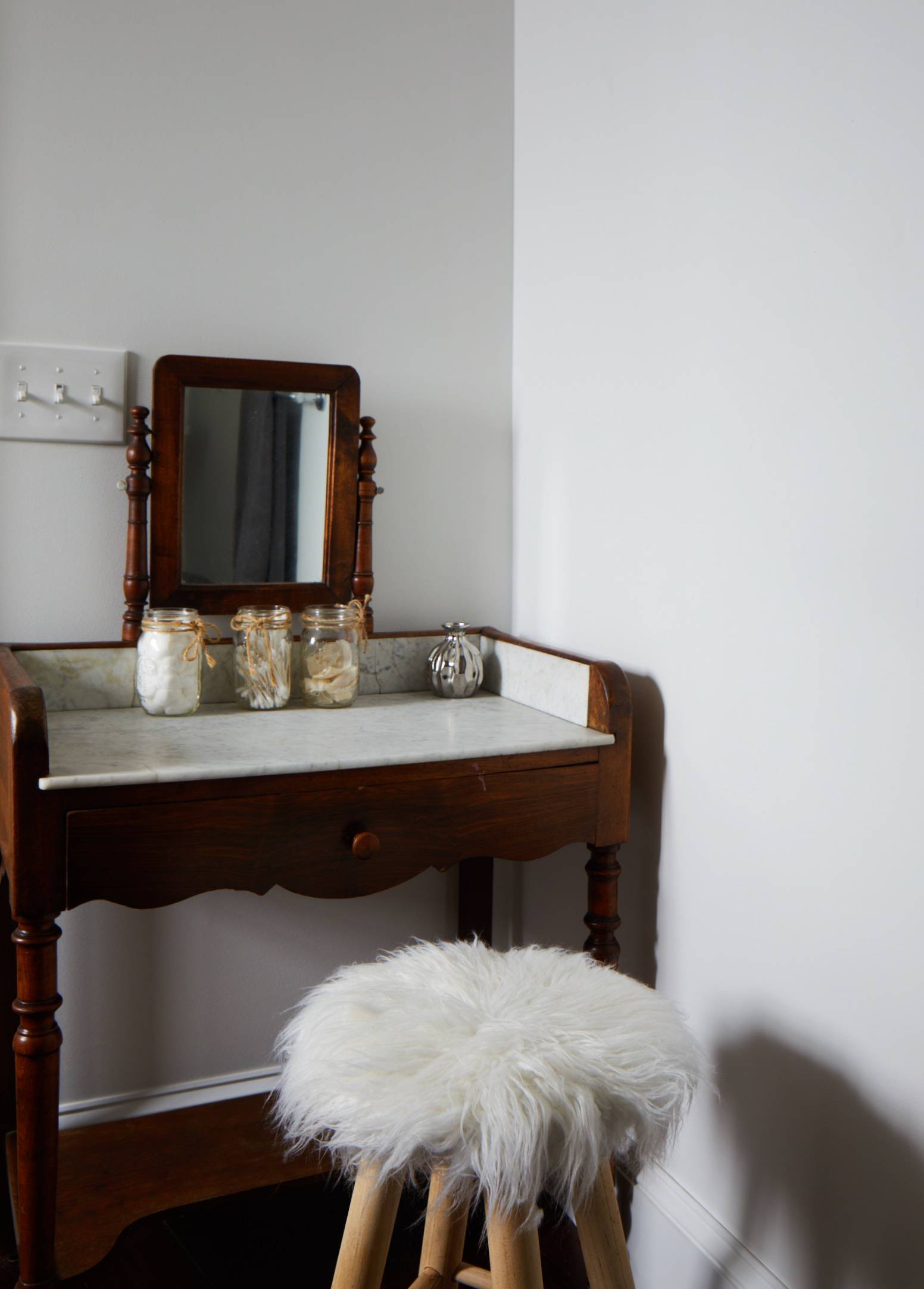 James Louis powder room marble top vanity with mirror and stool