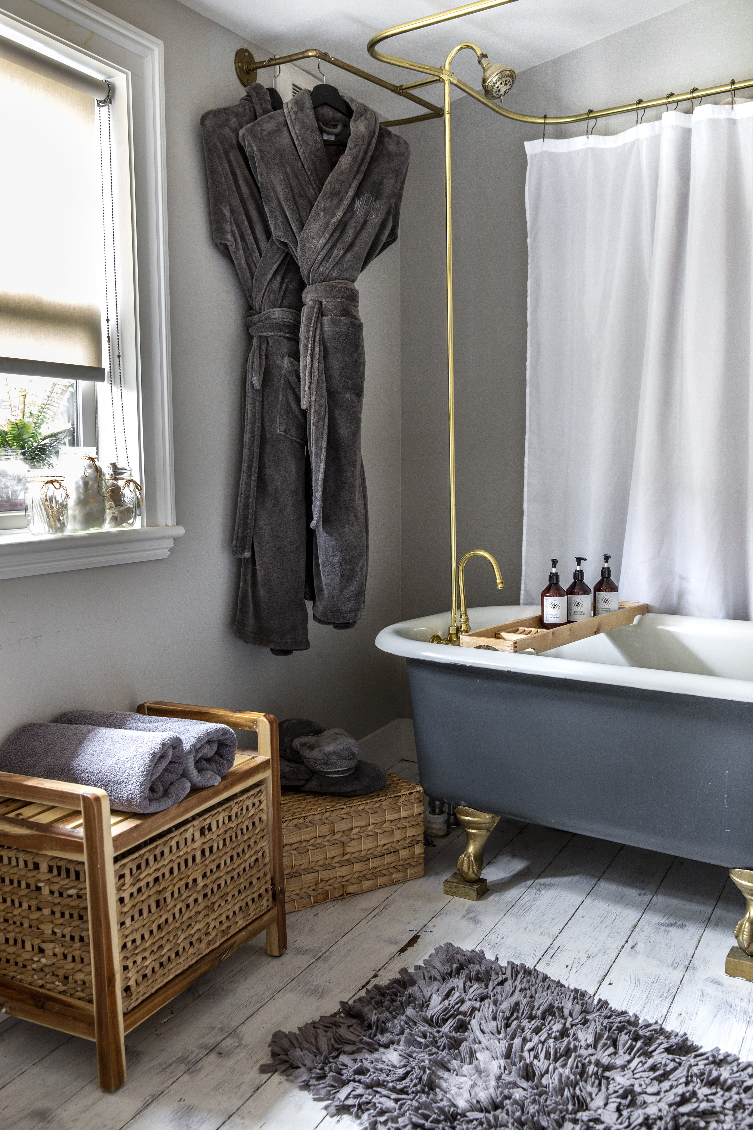 The Lee Wendell Suite - luxurious robes hanging in bathroom with full tub and shower