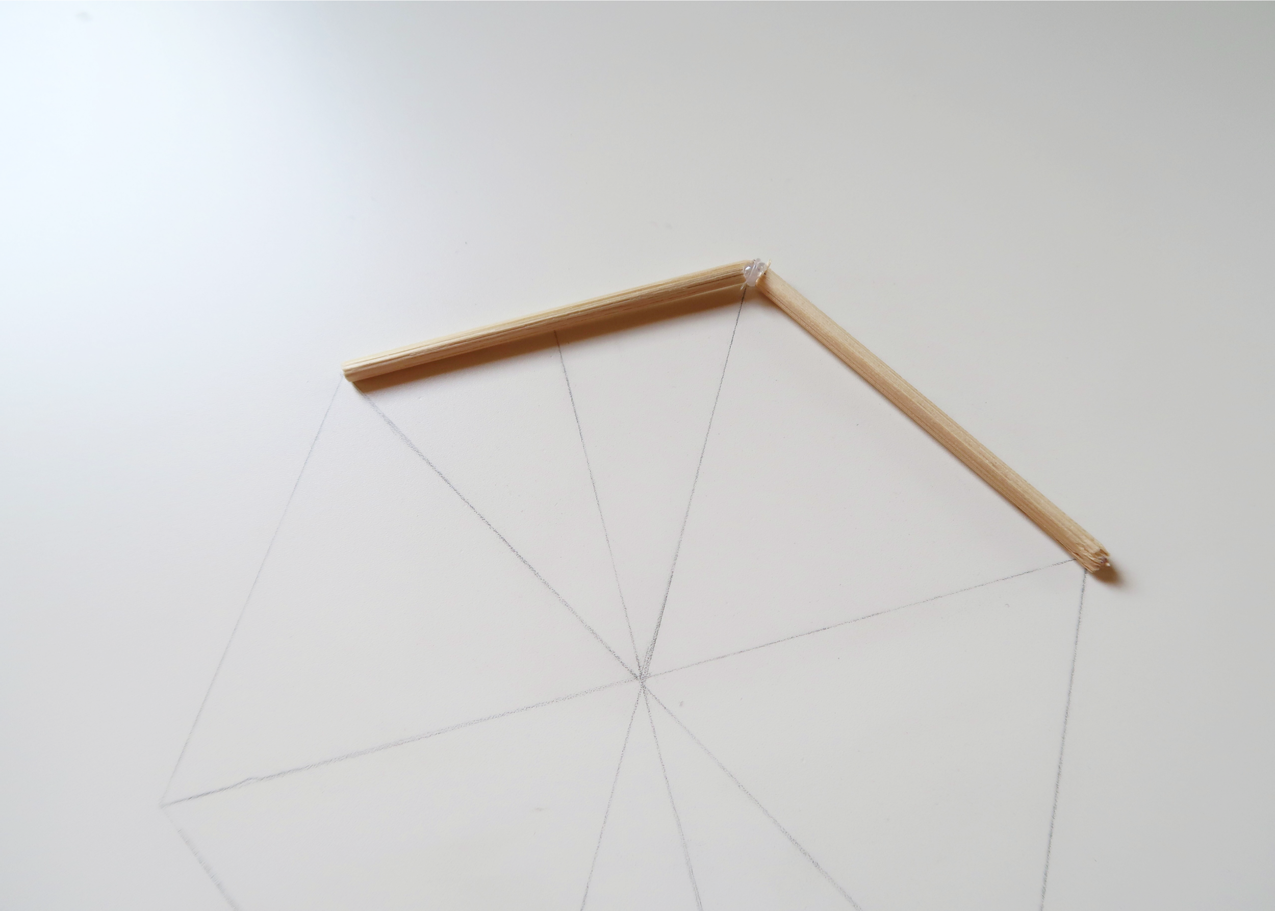 2. - Its helpful to draw out a hexagon first to guide your glueing. Once you're happy with your drawing, grab the 6cm skewers and glue them together. Do this one piece at a time, leaving them to dry in between, so that you can get the angle precise.