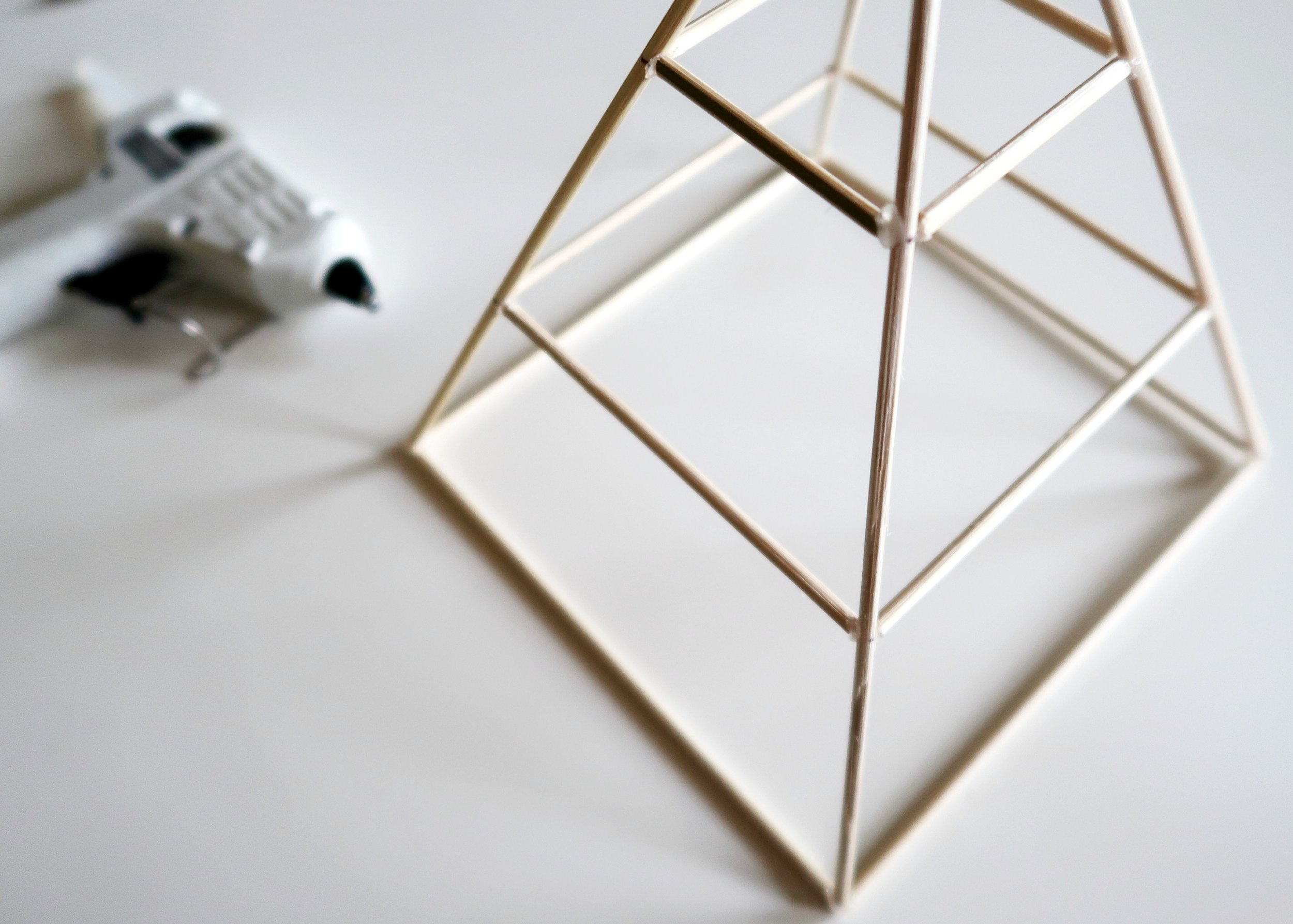 5. - Finally, take the 4.6cm lengths and glue these one at a time at the next mark along the sides of the pyramid. Once this is dry, you can leave it bare or use spray paint to give it a splash of colour.