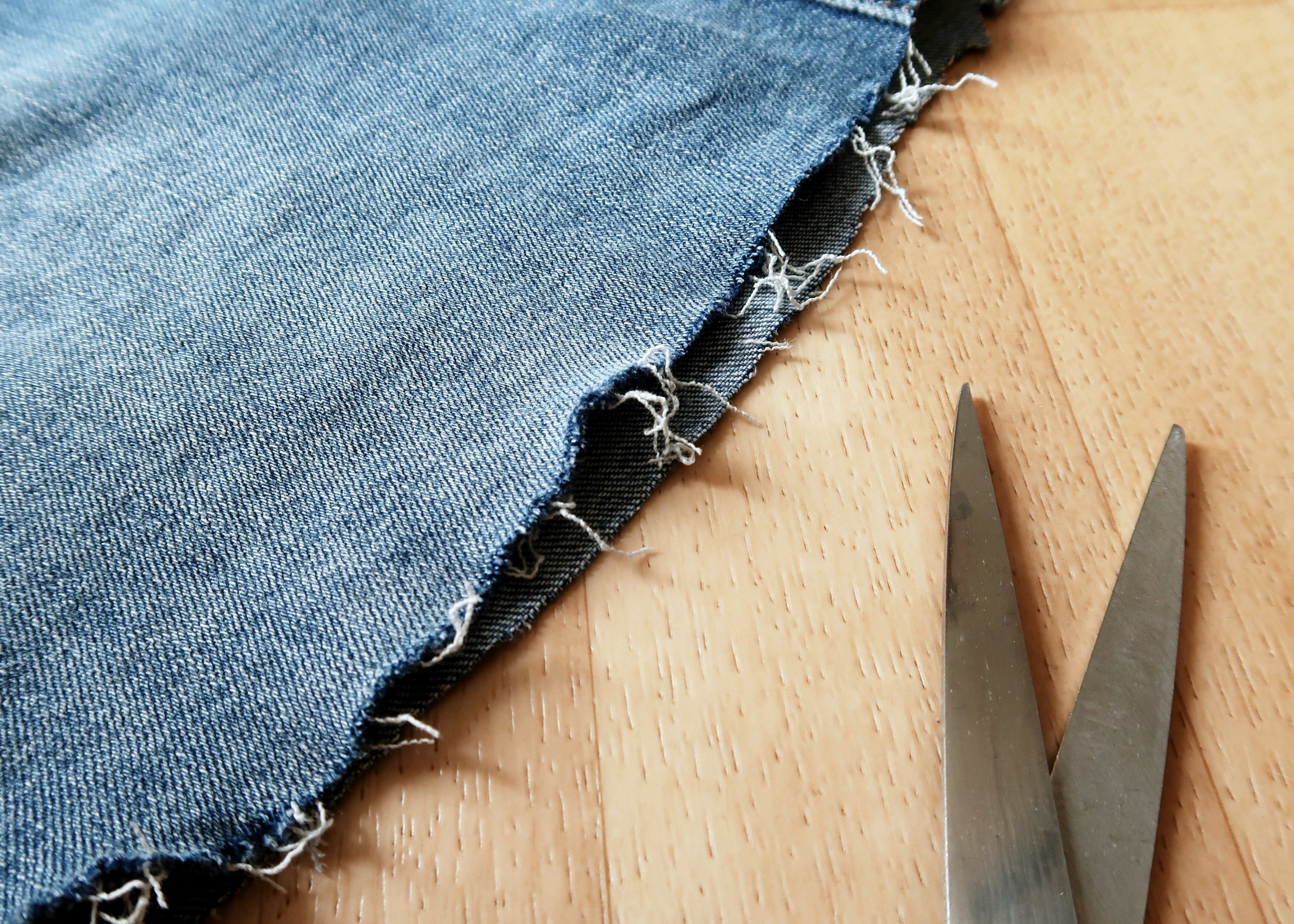 1. - First of all, you're going to want to cut your skirt to the length you want. Once you're happy with the length, use your scissors to sort of 'scour' the edges and fray the hem. This will give you a nice raw hem effect.