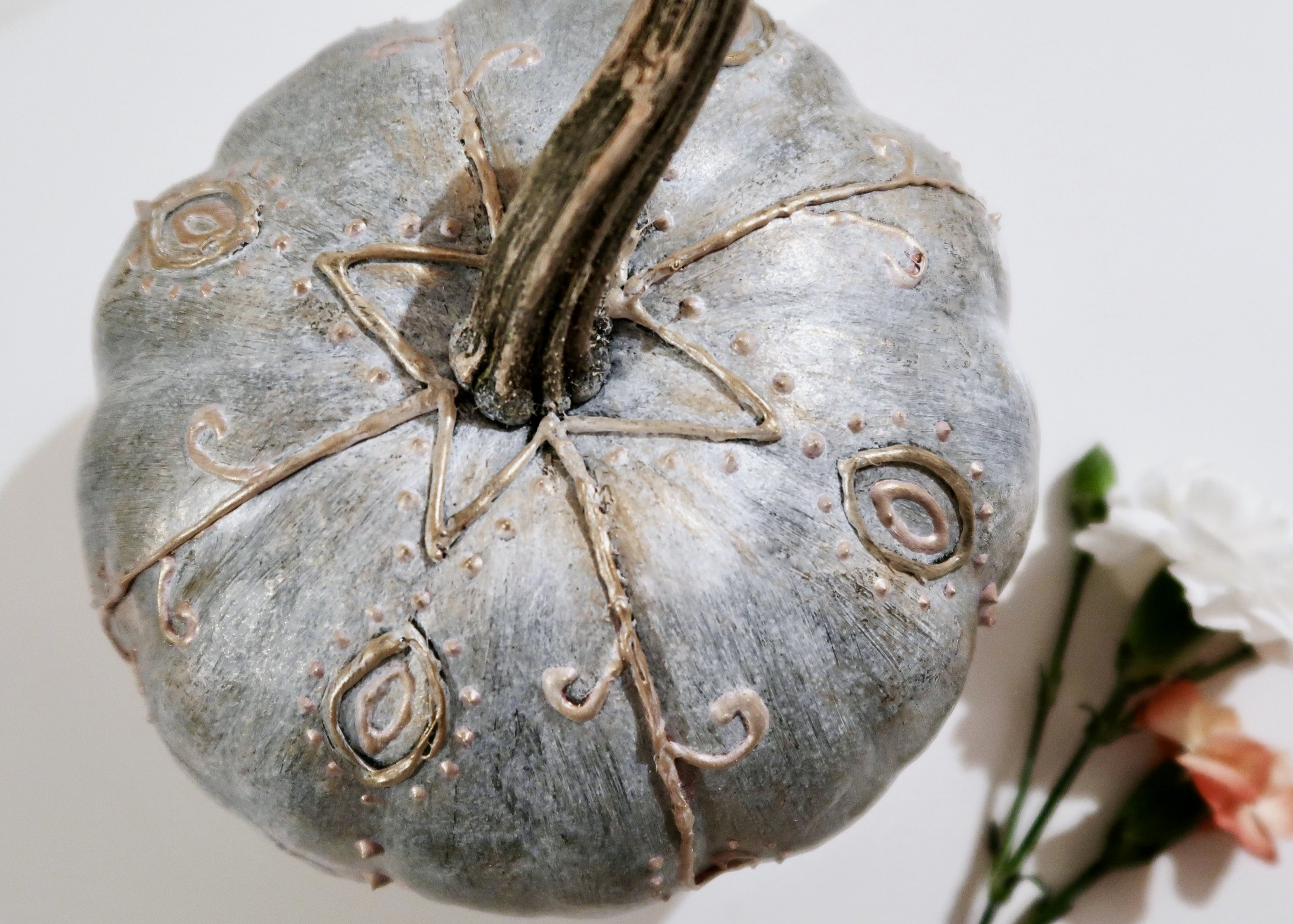 5. - Once dry, dry brush gold acrylic paint all over the pumpkin being sure to focus it on the glue and fabric paint. To dry brush, wipe most of the paint off of the brush onto a tissue before painting.