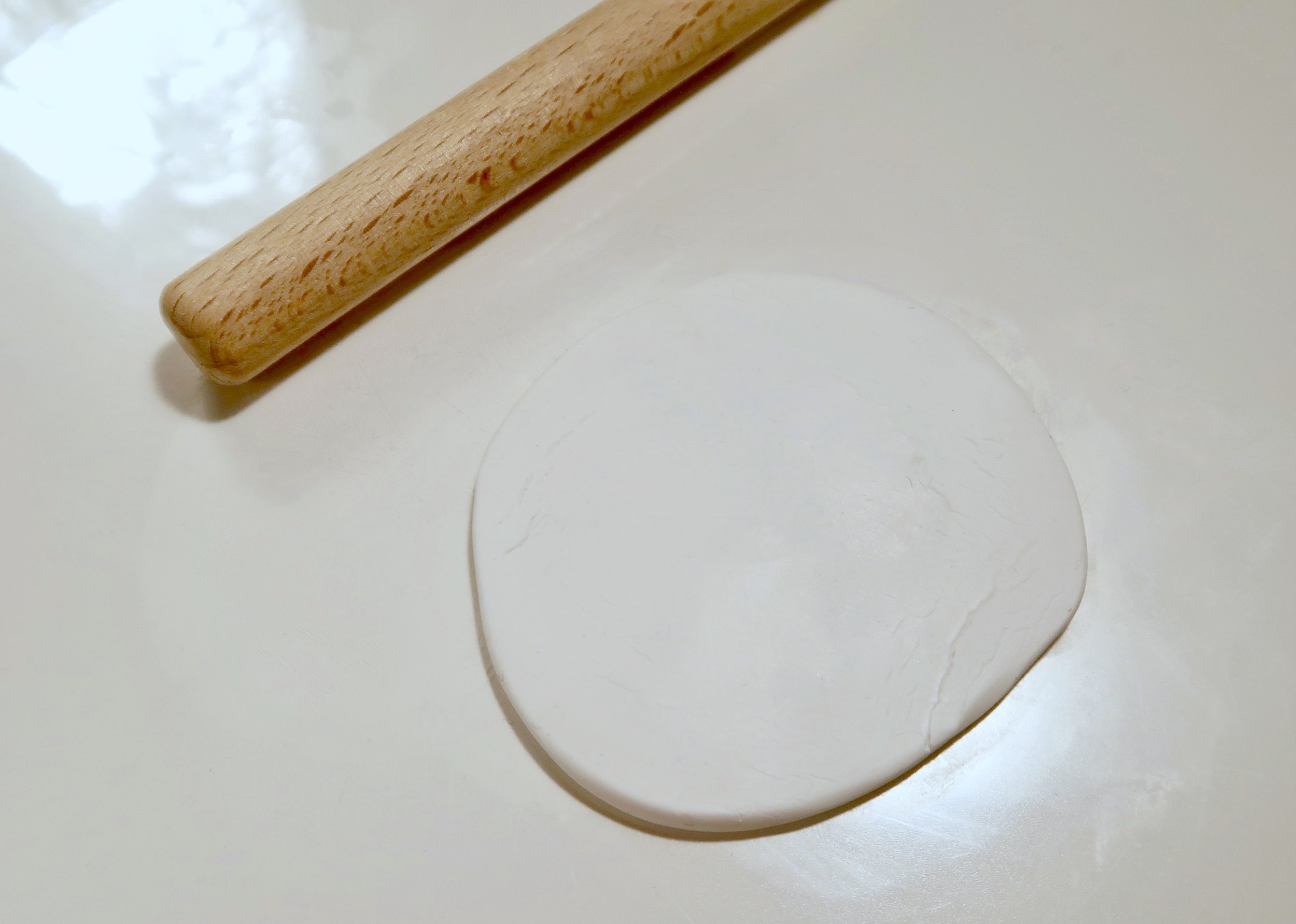 1. - First of all, you want to soften some clay in your hands and roll it out so that it is larger than your cutter or cookie cutter. Although I didn't use it myself this time (I seem to have misplaced it!) an acrylic roller works really well for this.