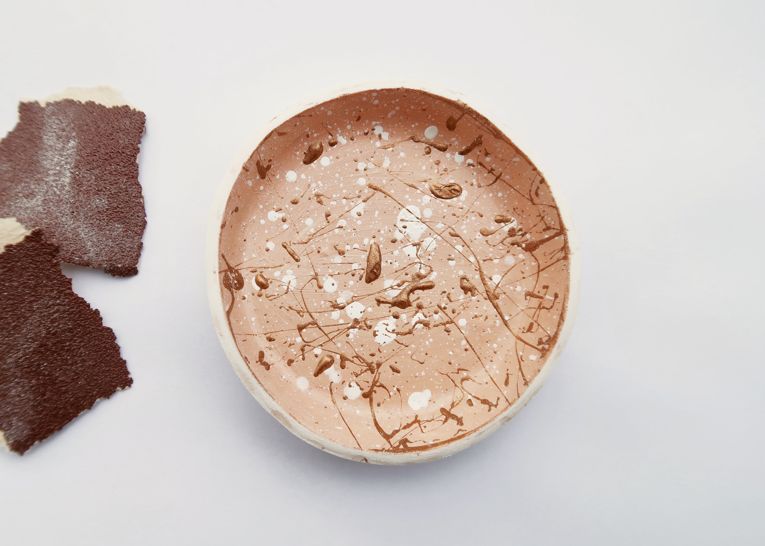 6. - I wanted to keep the outside of the dish the colour of the clay (that sort of earthy white) and so once all my paint was dry, I sanded the outside of the dish again to remove any accidental splodges of paint.