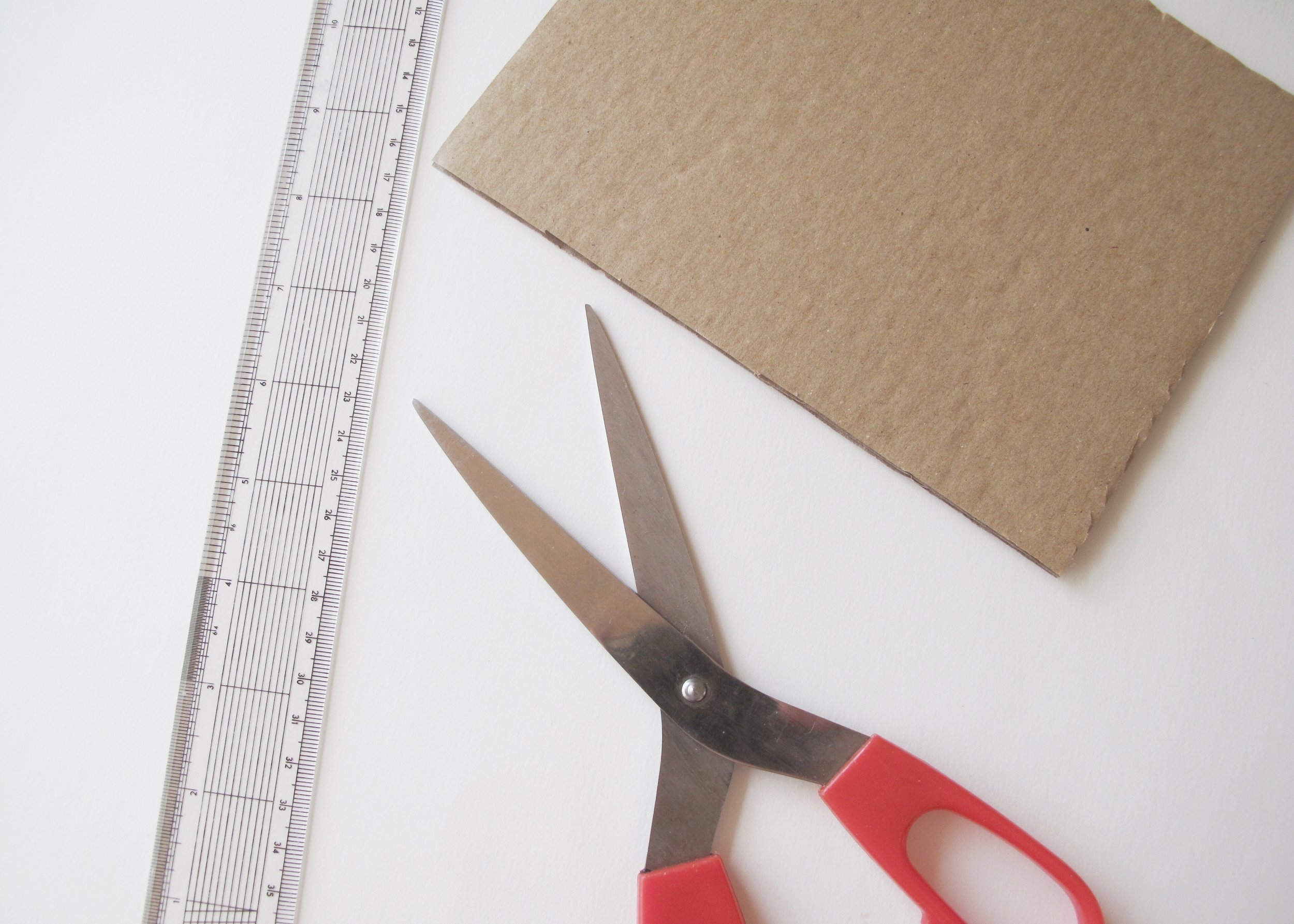 2. - Next, measure the length of your zip. This is going to be the width of your bag. Use this measurement to draw out a rectangle on a piece of card, which is the size that you would like your bag to be.