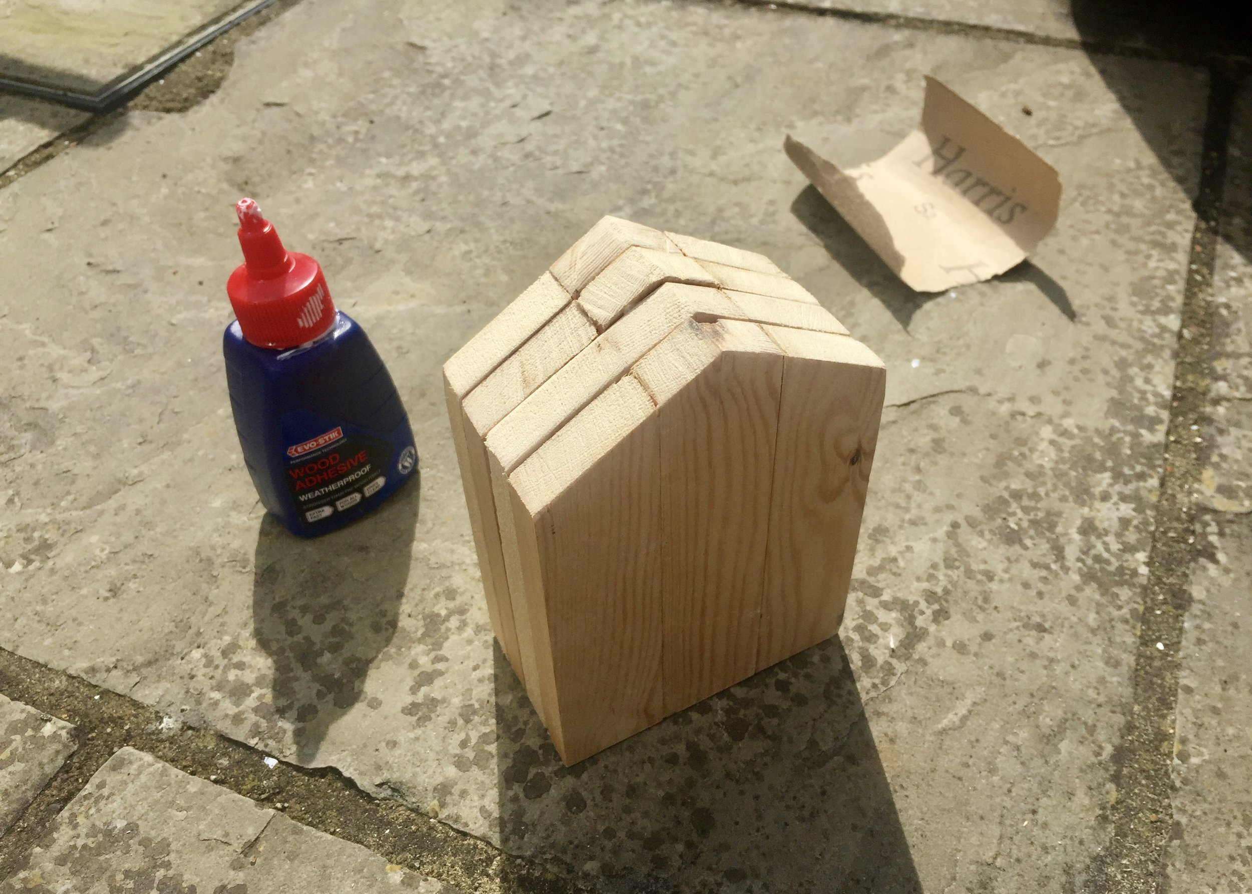 4. - Once the glue is dry, glue these 2D shapes on top of each other to create a 3D house shape. Again, be sure to line up the bottom as best as you can and leave it to dry completely. Using a sanding block and sand paper, I then evened out the top, bottom and sides.