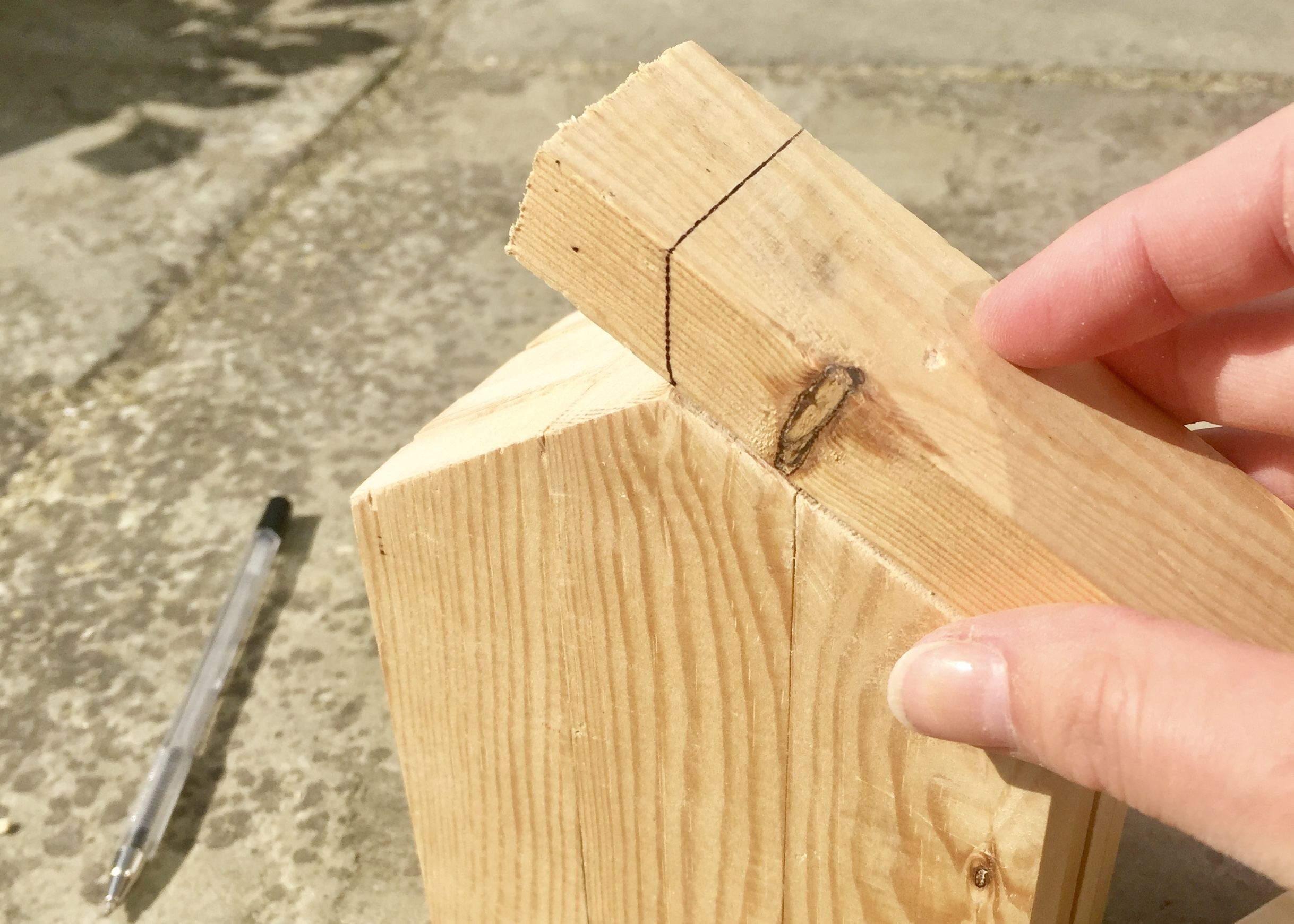 5. - With the remaining 4 lengths of wood, I used these to create a roof for my bee hotel by positioning them on the house and marking where I would need to cut. I wanted the roof to overhang a little bit and so on the outer edge I cut approximately 1.5cm more than I needed.