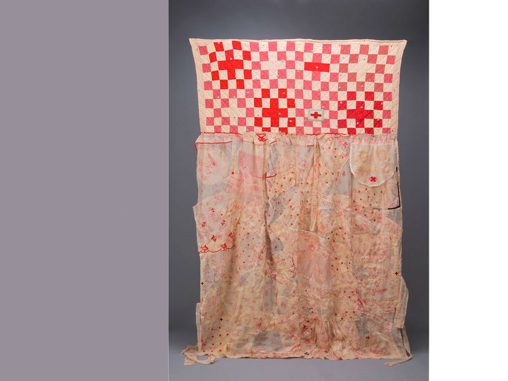 Curiosities: You're Ruining My Epiphany   2008 Screen-print, embroidery on antique organdy objects; hand-stitched; vintage quilt top, red cross buttons