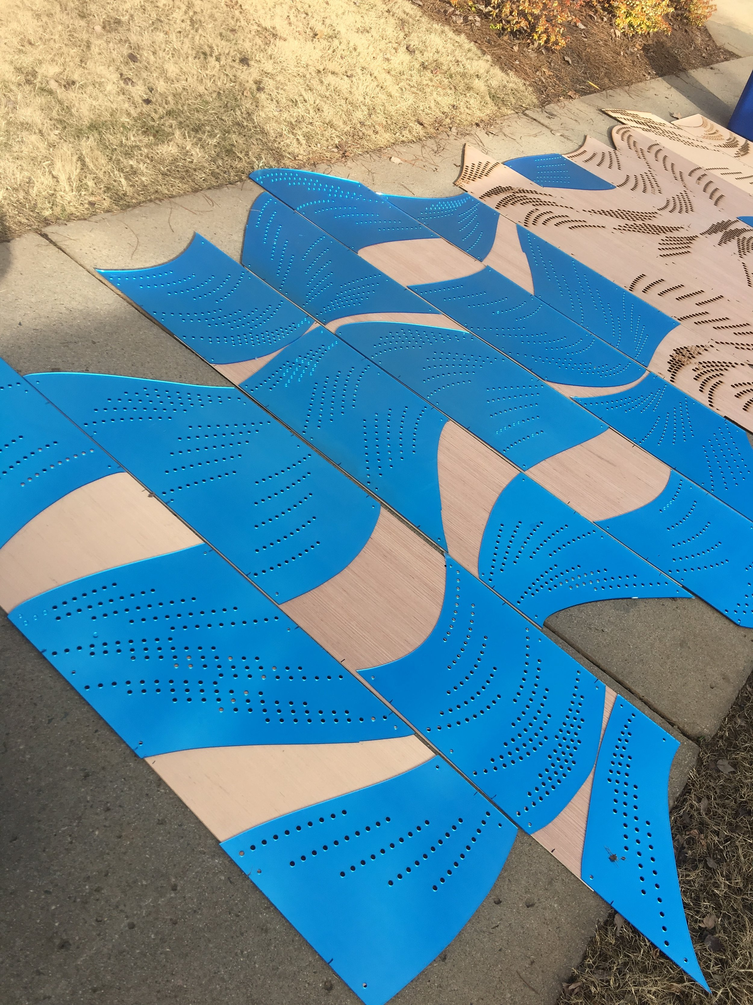 Lining up mirrored acrylic pieces with the plywood