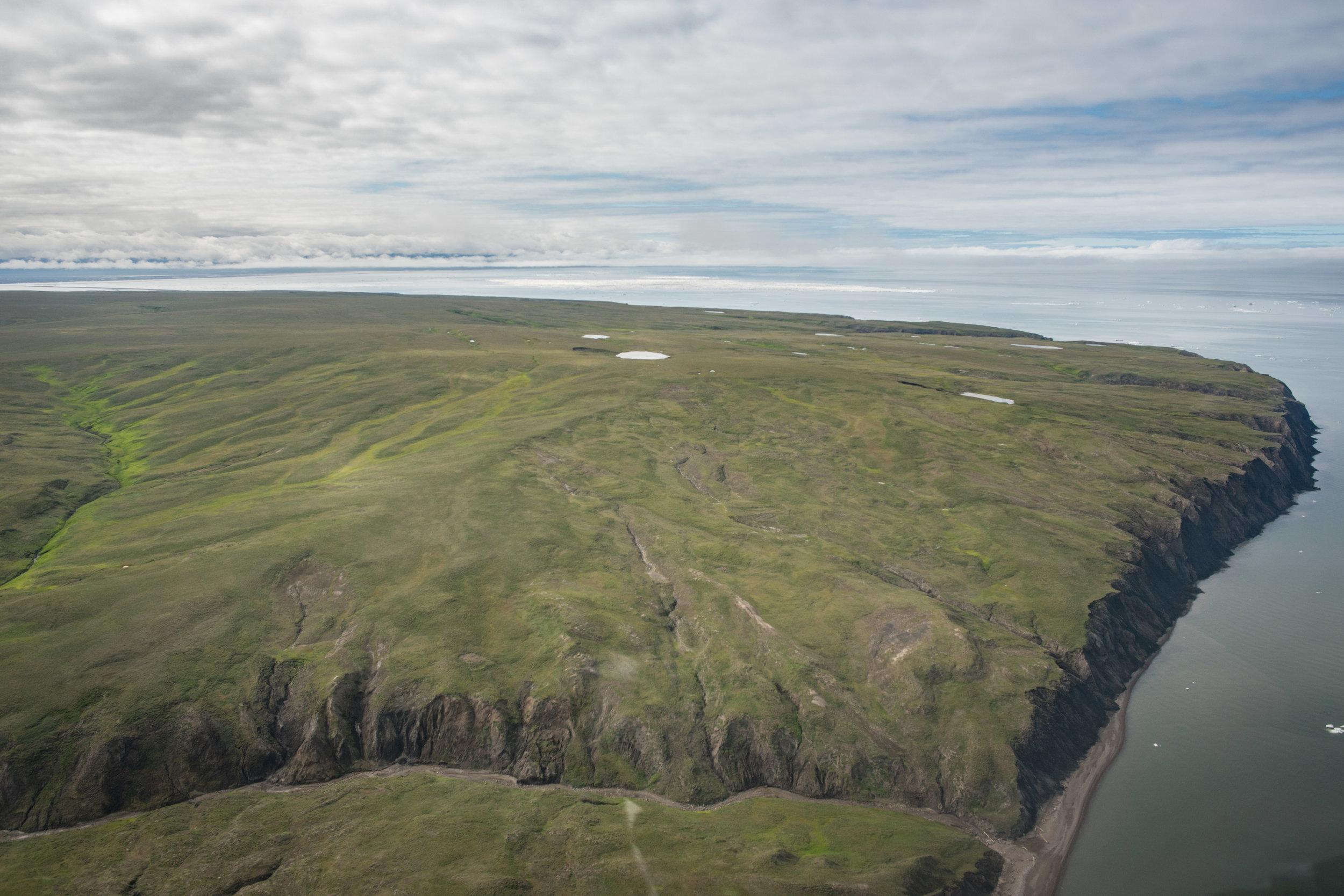 The northwestern corner of Qikitaryuk, sunlit sea ice beyond